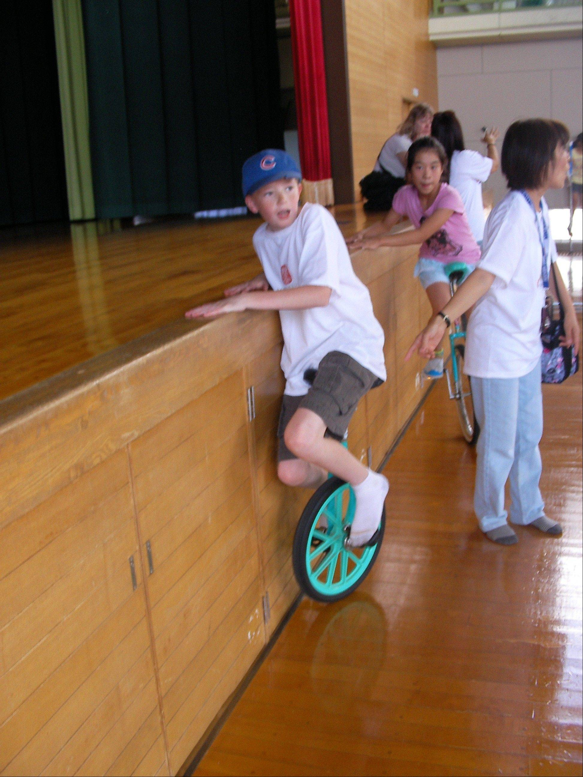 Brian Quill attempts the unicycle at Namerikawa's Higashi Kazumi-Cho Elementary School.