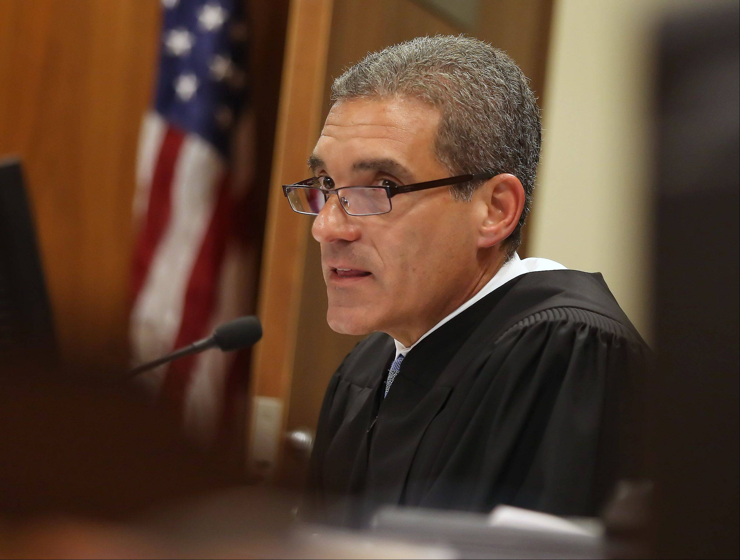 Lake County Judge Mark Levitt announces the verdict in Ronald Stolberg's sentencing hearing Thursday. He was sentenced to eight years in prison for involuntary manslaughter in the death of his wife, Rachel.