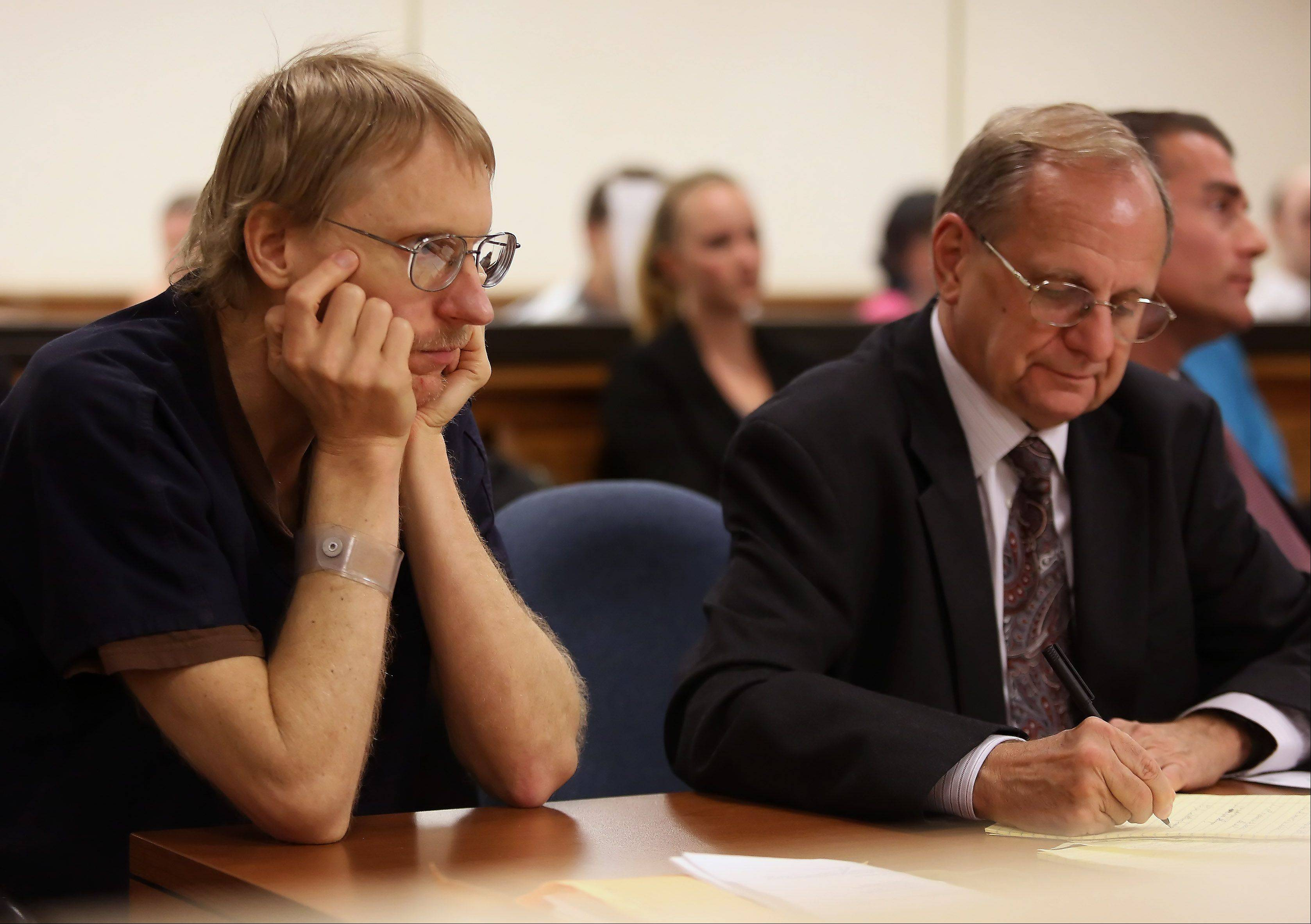 Ronald Stolberg, left, sits with his attorneys William Hedrick and Kevin Rosner during his sentencing hearing Thursday in Waukegan.