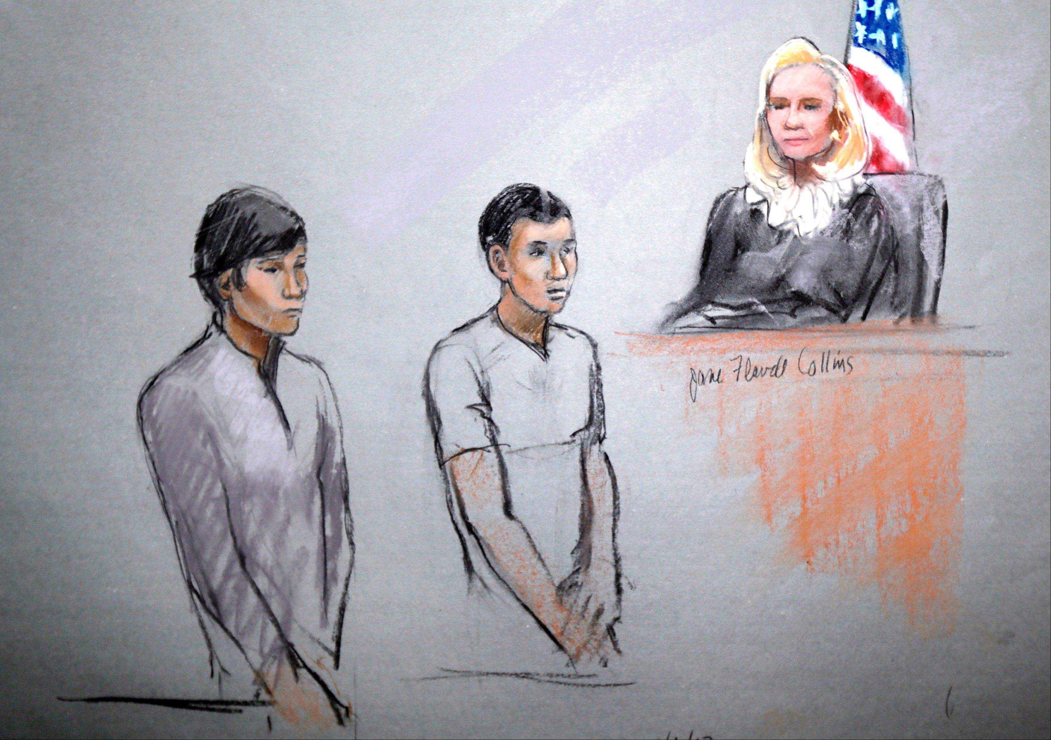 FILE--This courtroom sketch of May 1, 2013 by artist Jane Flavell Collins shows defendants Dias Kadyrbayev, left, and Azamat Tazhayakov appearing in front of Federal Magistrate Marianne Bowler at the Moakley Federal Courthouse in Boston. The two college friends of Boston Marathon bombing suspect Dzhokhar Tsarnaev have been indicted Thursday, Aug. 8, 2013 on obstruction conspiracy charges. Dias Kadyrbayev and Azamat Tazhayakov are accused of trying to dispose of evidence from Dzhokhar Tsarnaev's dorm room. The two 19-year-olds have been detained since they were initially charged in May. If convicted, they face up to 20 years in prison.