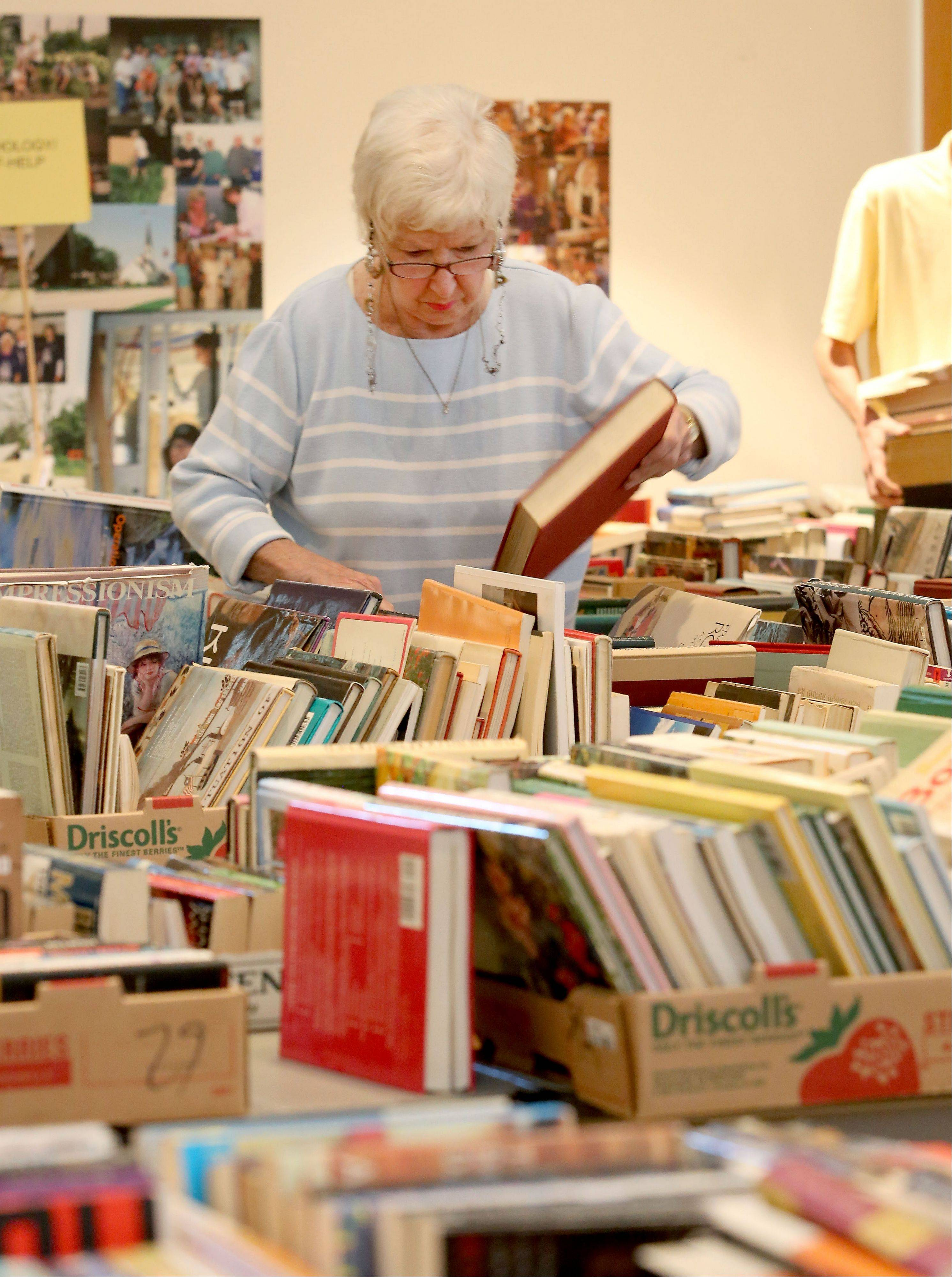 Pat Warren of Glen Ellyn looks through the books at the Lombard Area AAUW's annual sale. Proceeds support local and national scholarships, grants and the group's legal advocacy fund.