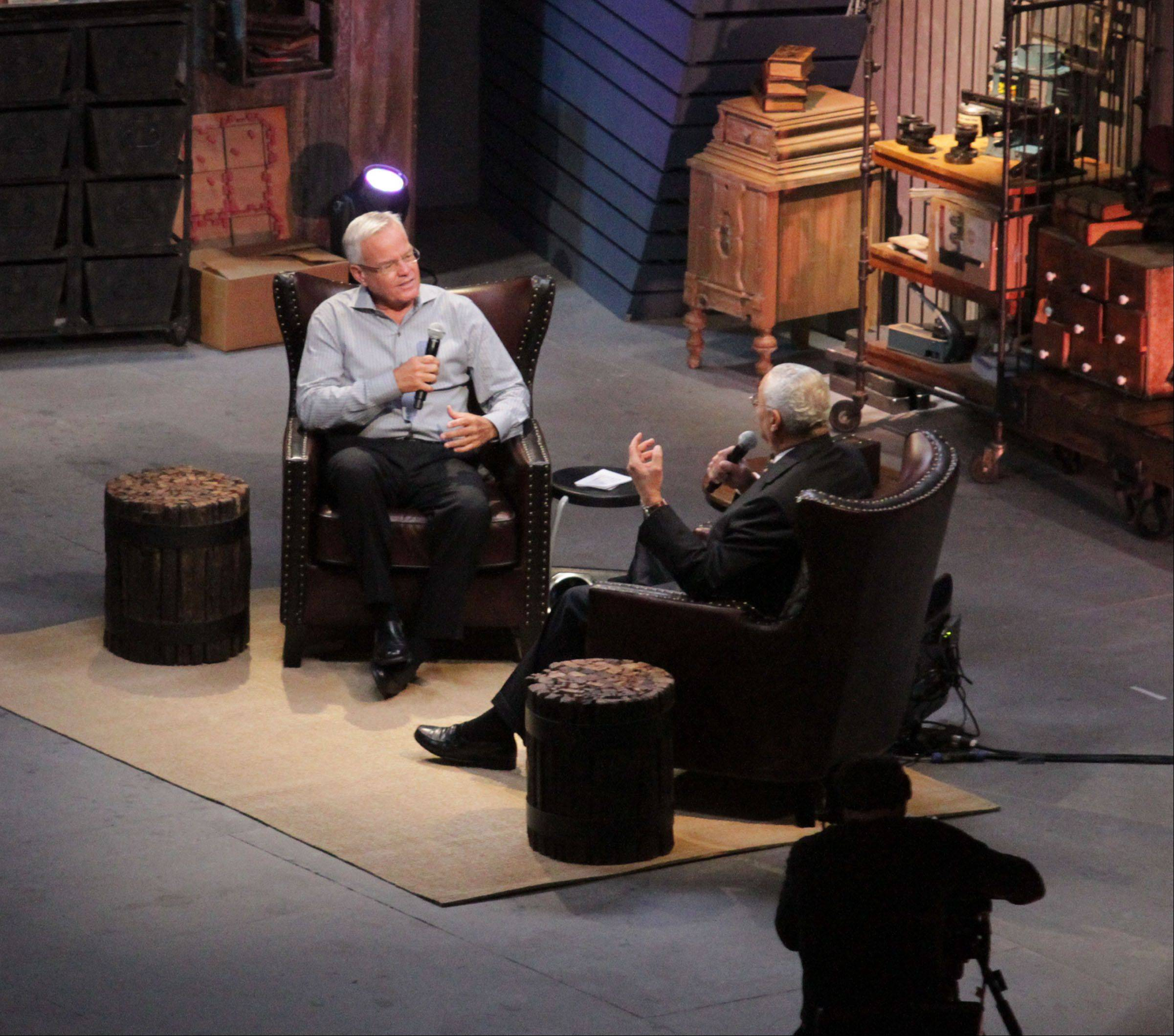 Bill Hybels, founder and senior pastor at Willow Creek Community Church, left, interviews Gen. Colin Powell.