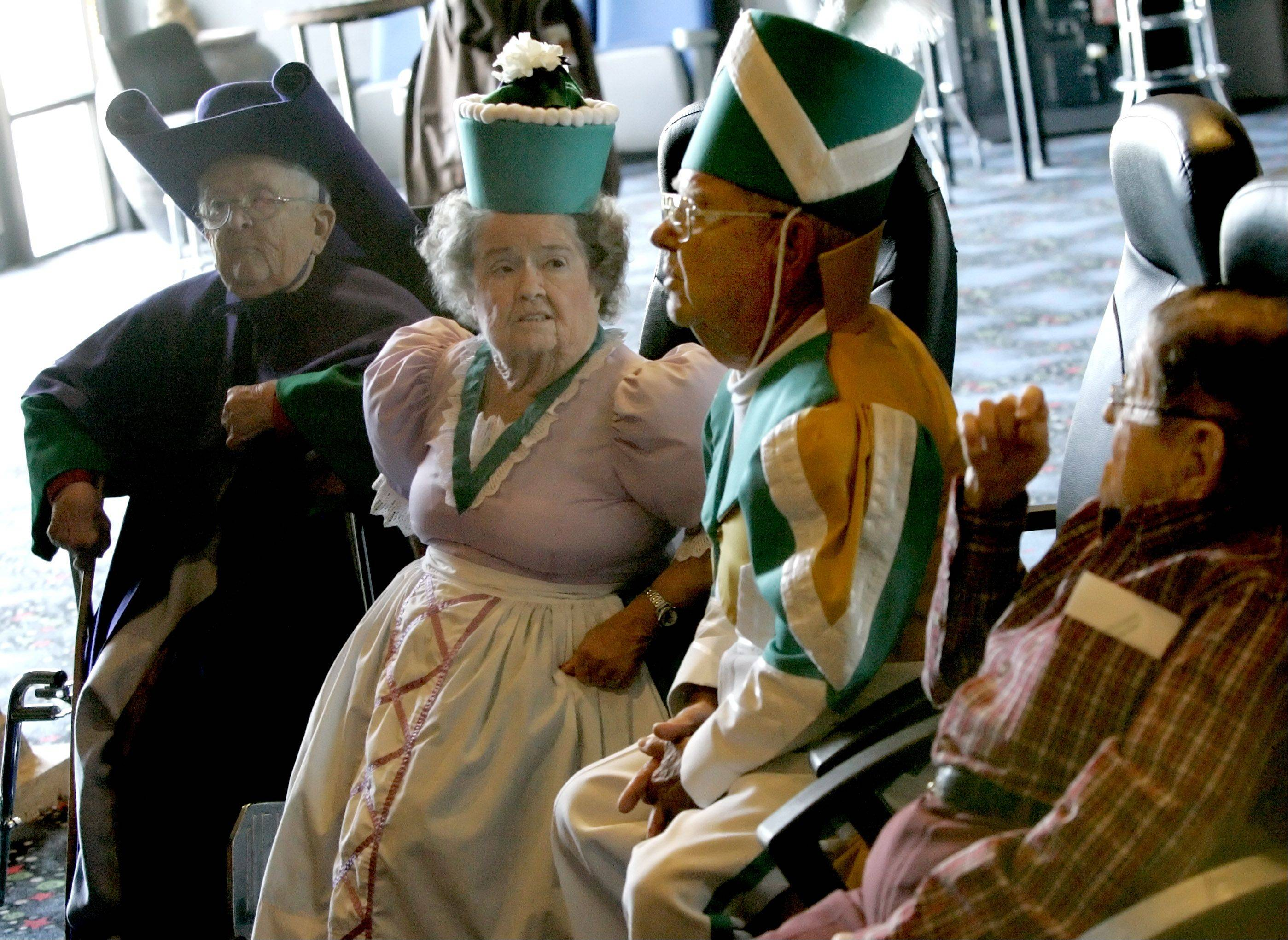 From left, Menhardt Raabe, Margaret Pellegrini, Clarence Swenson and Karl Slover, all munchkins that appeared in the film The Wizard of Oz in Woodridge at the Hollywood Blvd movie theater for a showing of the film in November 2005.