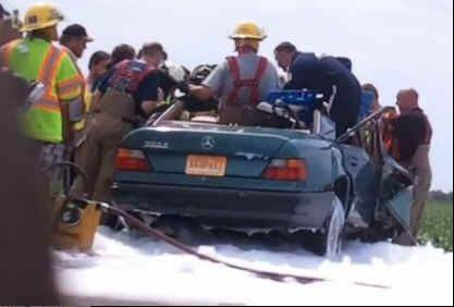 Rescue workers in northeast Missouri struggled to extricate a young woman involved in a serious car wreck -- until a mysterious priest arrived and helped calm rescuers and the victim.