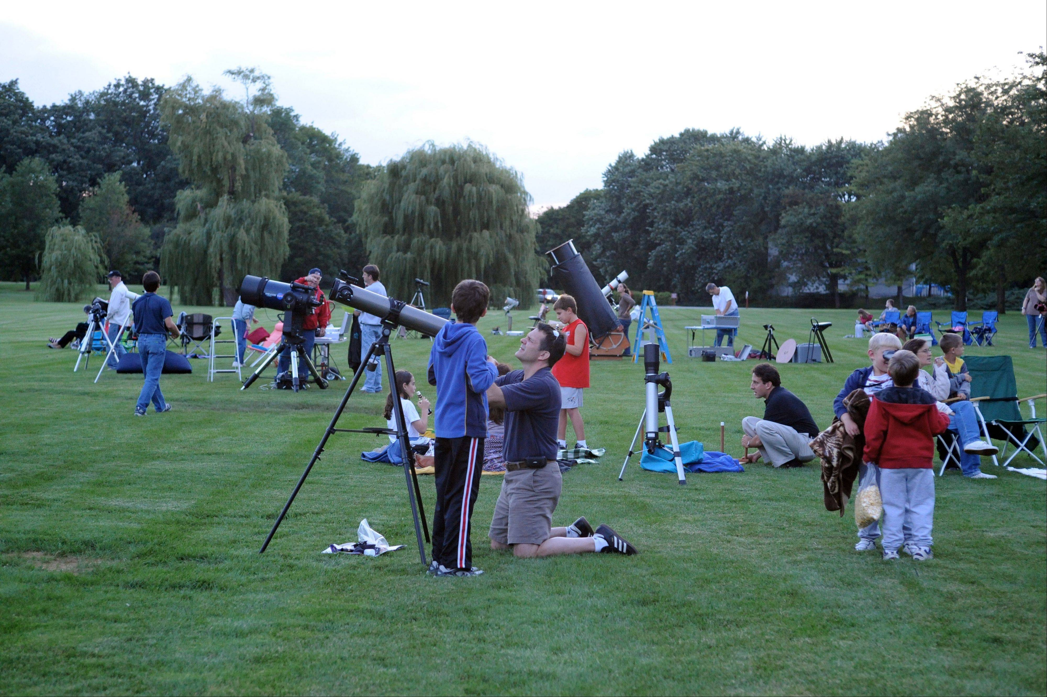 People gather on the grounds of Cantigny Park in Wheaton each year for the Adler Planetarium's annual Perseid Meteor Shower Star Party. This year's party is Monday night, Aug. 12.