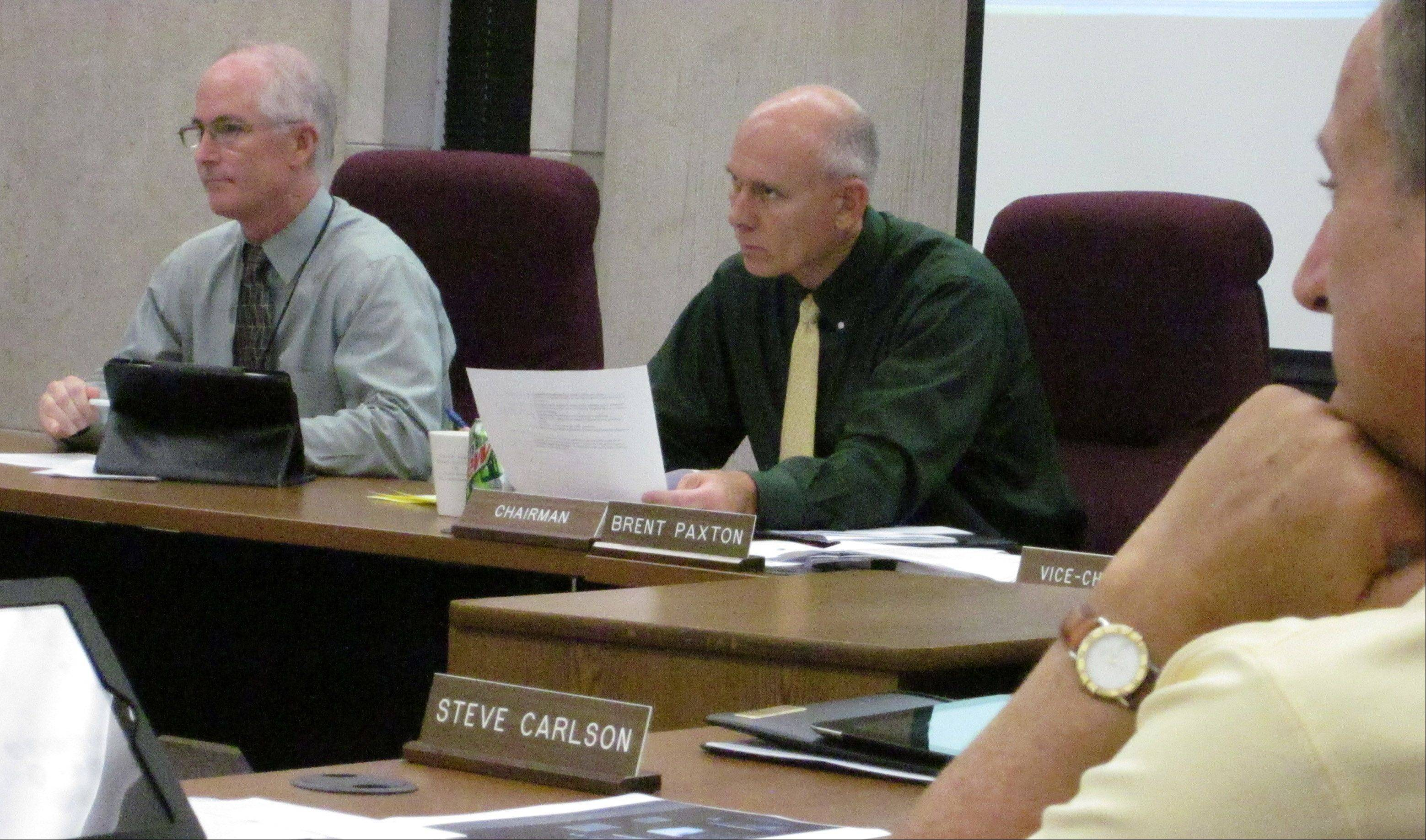 County Administrator Barry Burton, left, and Brent Paxton, chairman of the Lake County Board�s financial and administrative committee, listen to discussion Wednesday.