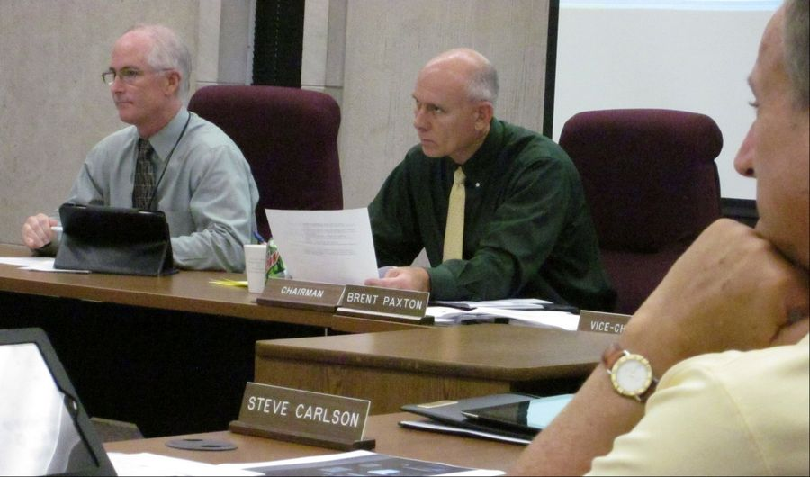 County Administrator Barry Burton, left, and Brent Paxton, chairman of the Lake County Board´s financial and administrative committee, listen to discussion Wednesday.