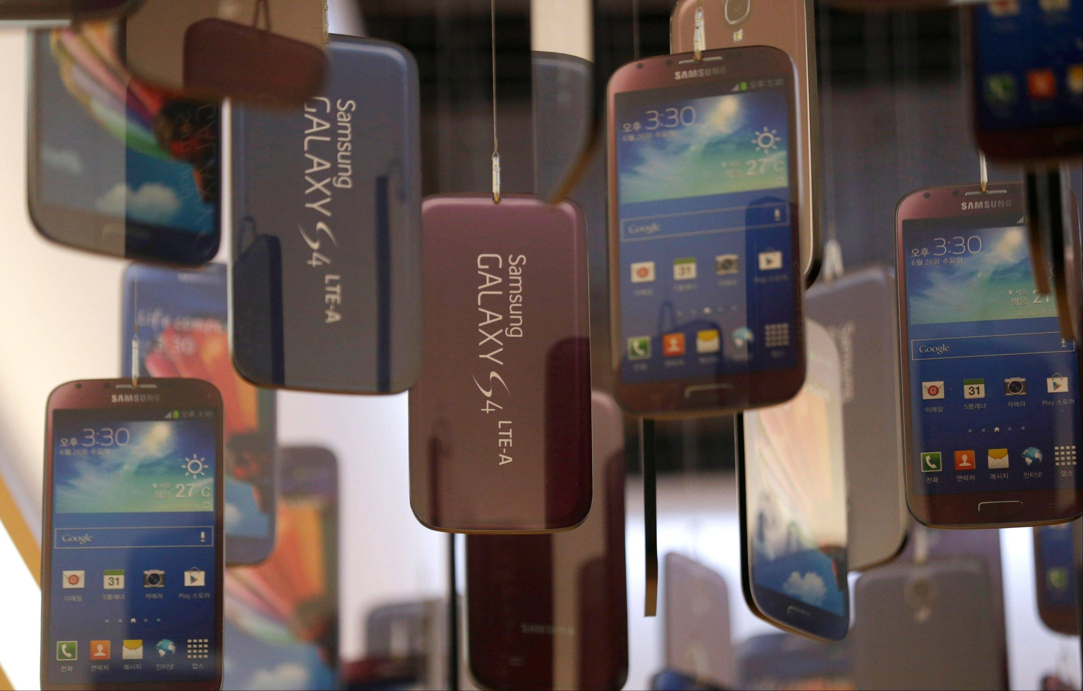Associated Press/July 26, 2013 Models of Samsung Electronics� Galaxy S4 smart phones are displayed at a showroom of its headquarters in Seoul, South Korea.