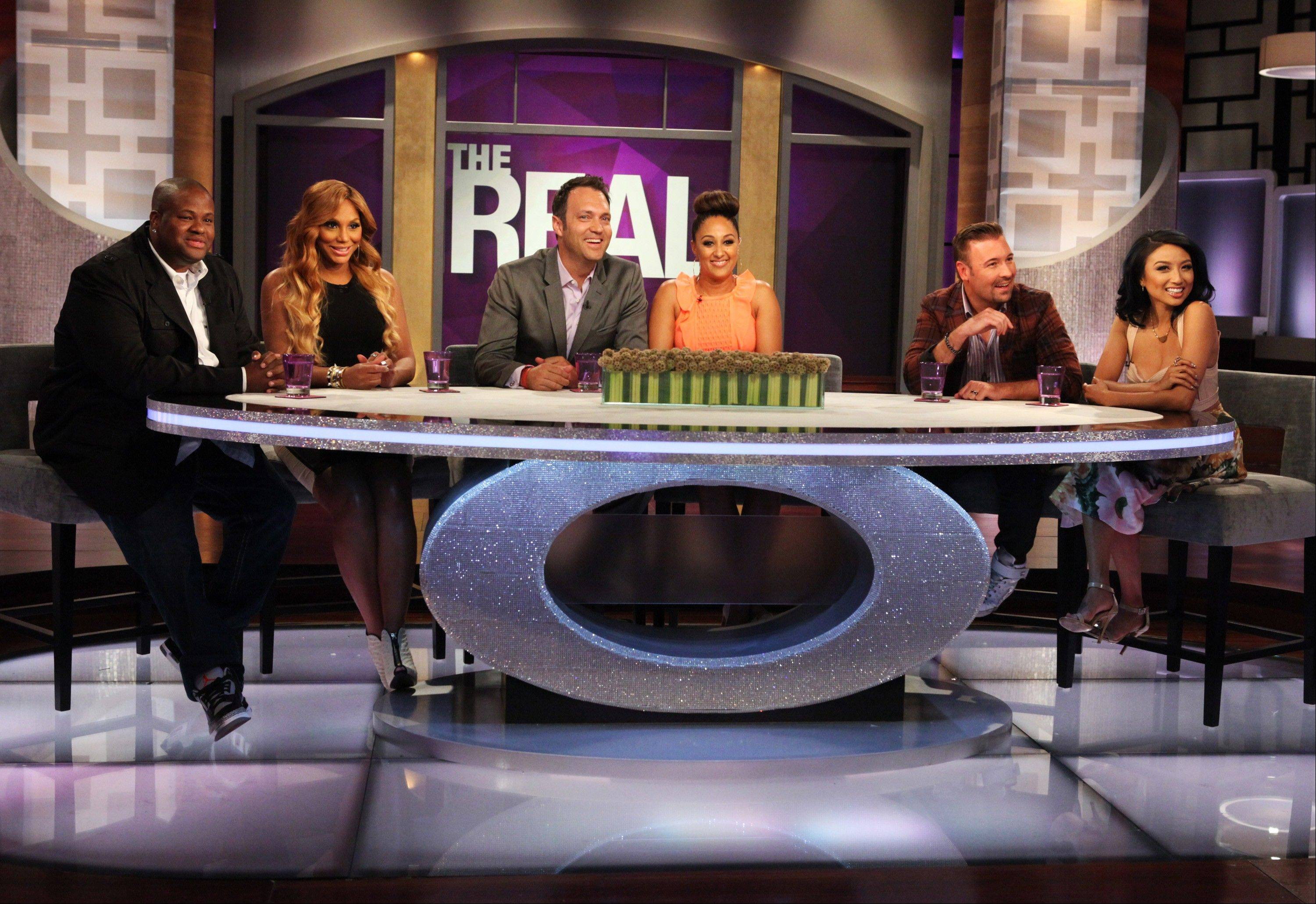 "Hosts Tamar Braxton, second left, with husband, Vincent Herbert, left, Tamera Mowry-Housley, center, with husband, Adam Housley, and Jeannie Mai, right, with husband Freddy Harteis, on the set of ""The Real."""