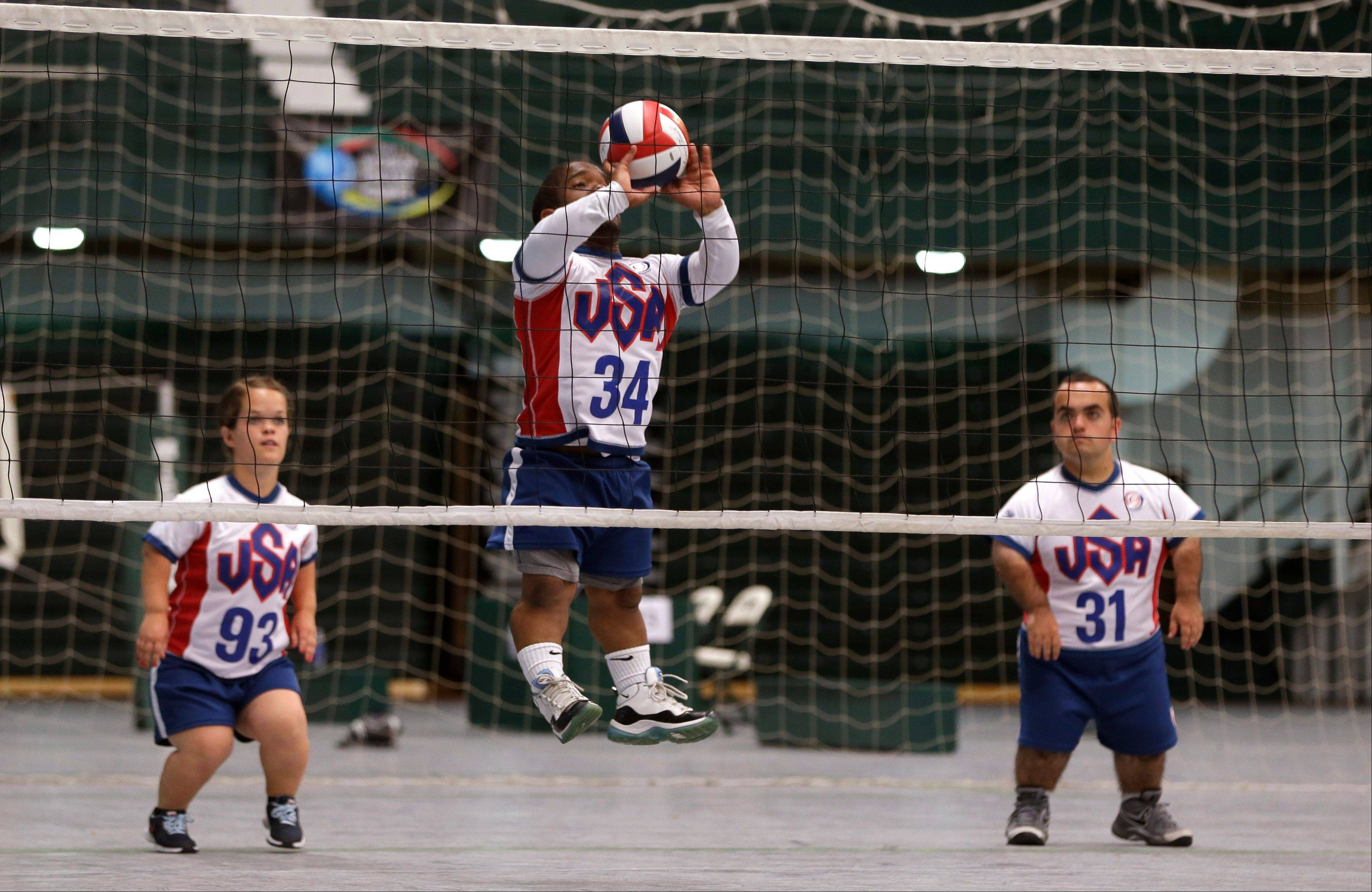 Blaze Foster (34) of the United States team returns a volley Thursday against the European volleyball team during a game at the 2013 World Dwarf Games in East Lansing, Mich.