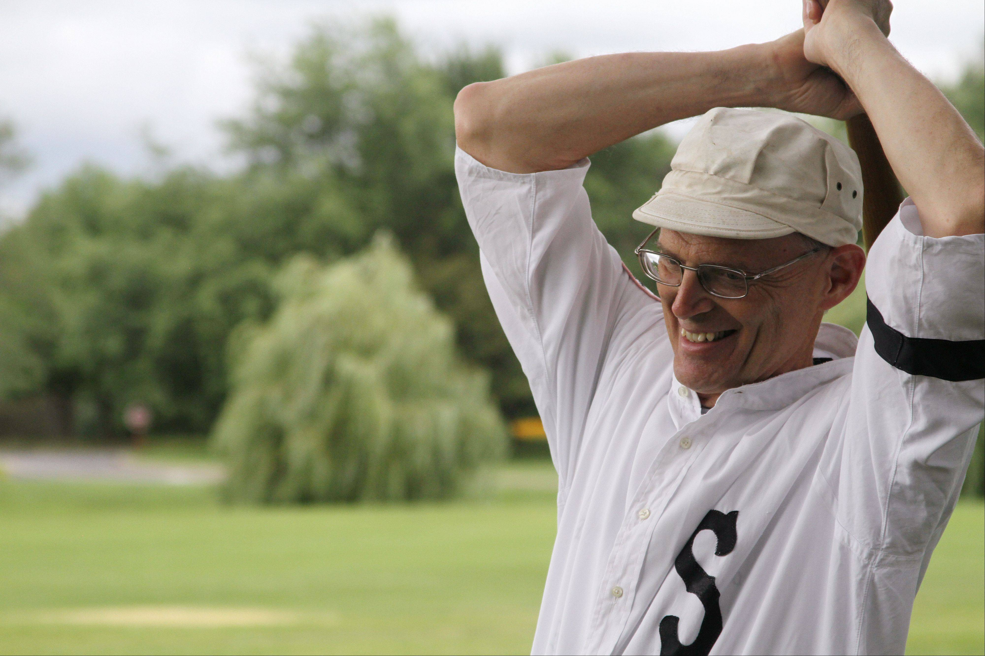 "Gary ""The Professor"" Schiappacasse of Vernon Hills stretches before a game at Cantigny Park on Saturday, July 27. He is the coach of the Chicago Salmon, a 1858-style re-enactment baseball team."
