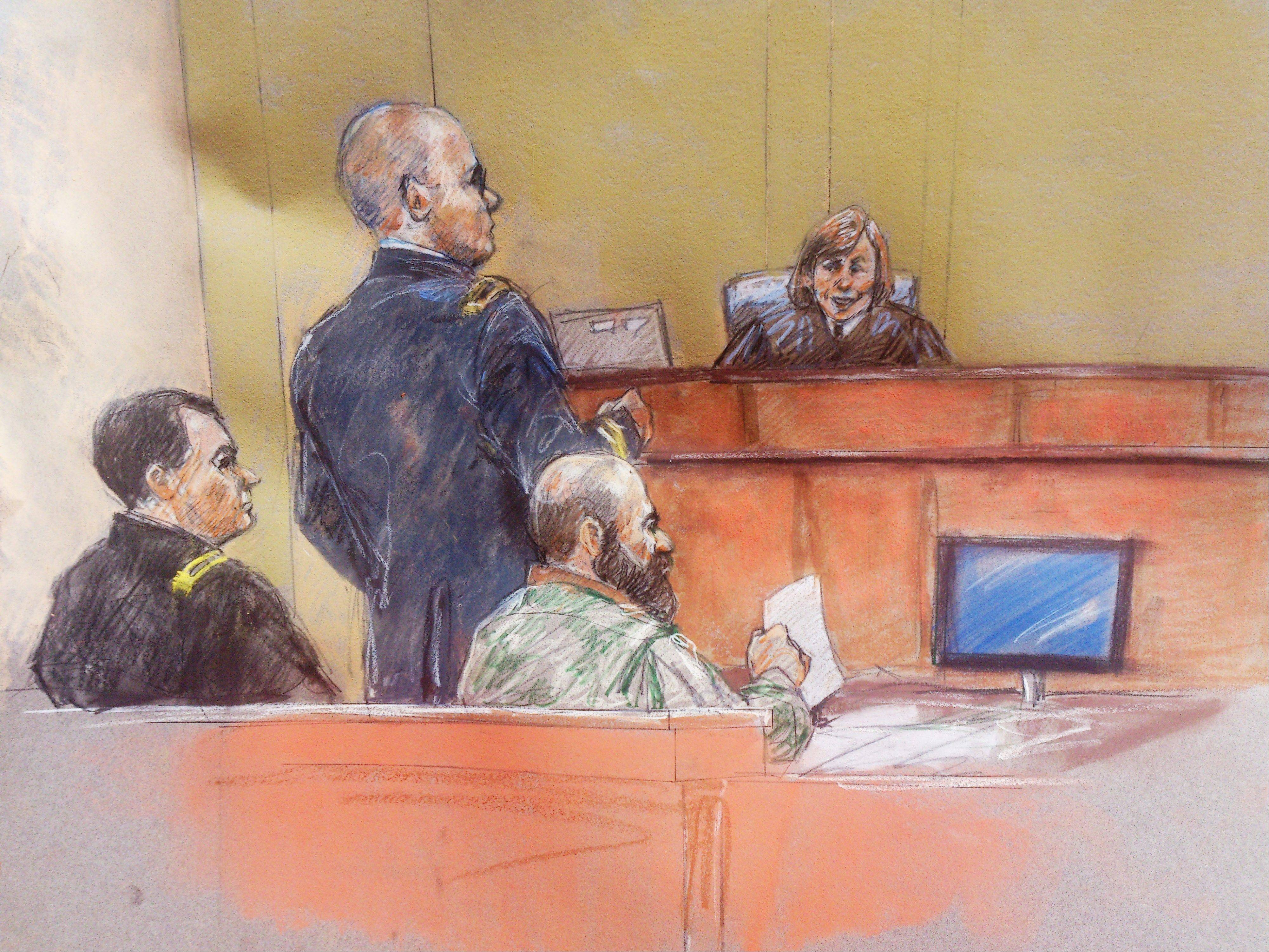 In this courtroom sketch, Maj. Nidal Hasan, second from right, sits with his standby defense attorneys Maj. Joseph Marcee, left, and Lt. Col. Kris Poppe, second from left, as presiding judge Col. Tara Osborn looks on, during Hasan's trial Thursday, Aug. 8, 2013, in Fort Hood, Texas. Hasan was allowed to continue representing himself on Thursday after the judge barred his standby attorneys from taking over, despite their claims that the Army psychiatrist was trying to secure his own death sentence.