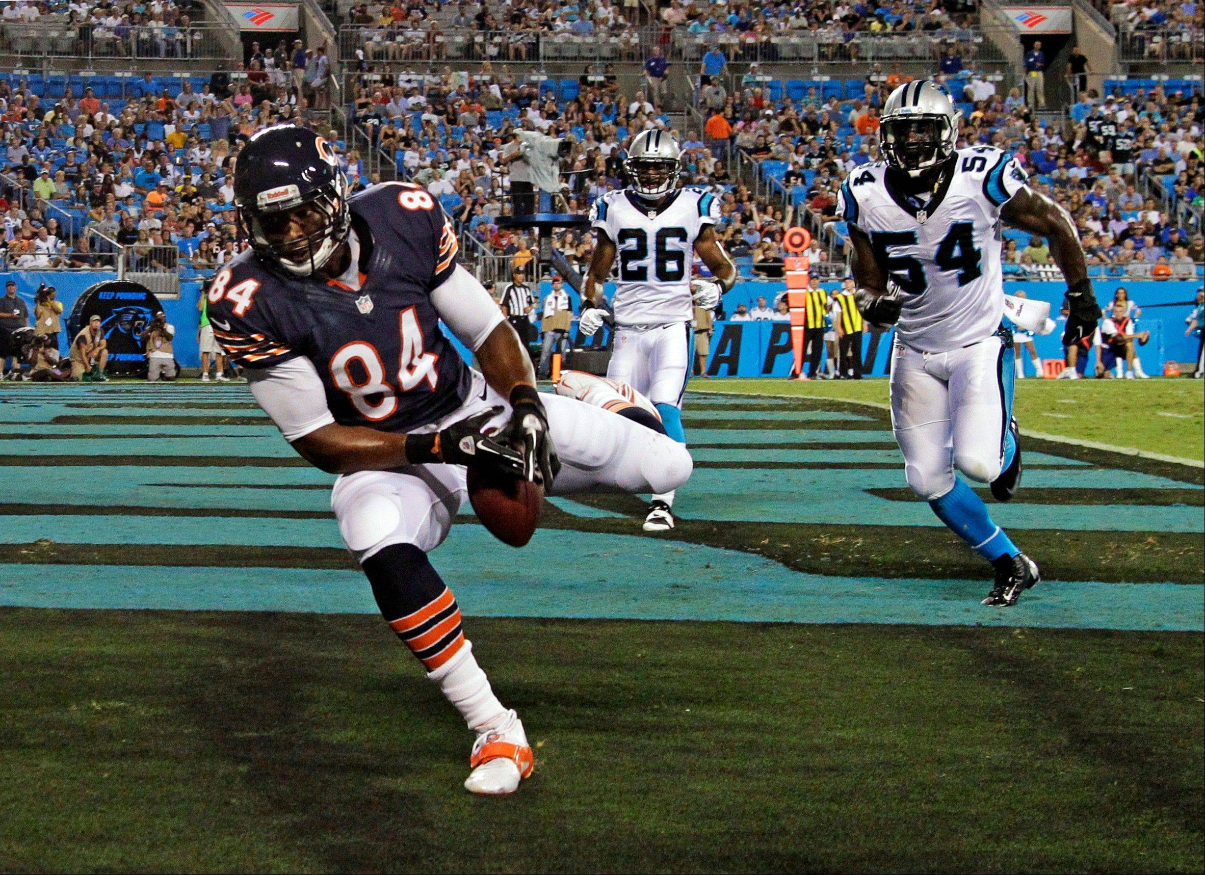 Chicago Bears' Fendi Onobun (84) drops a pass in the end zone as Carolina Panthers' Jason Williams (54) and D.J. Campbell (26) defend during the first half of a preseason NFL football game in Charlotte, N.C., Friday, Aug. 9, 2013. (AP Photo/Bob Leverone)