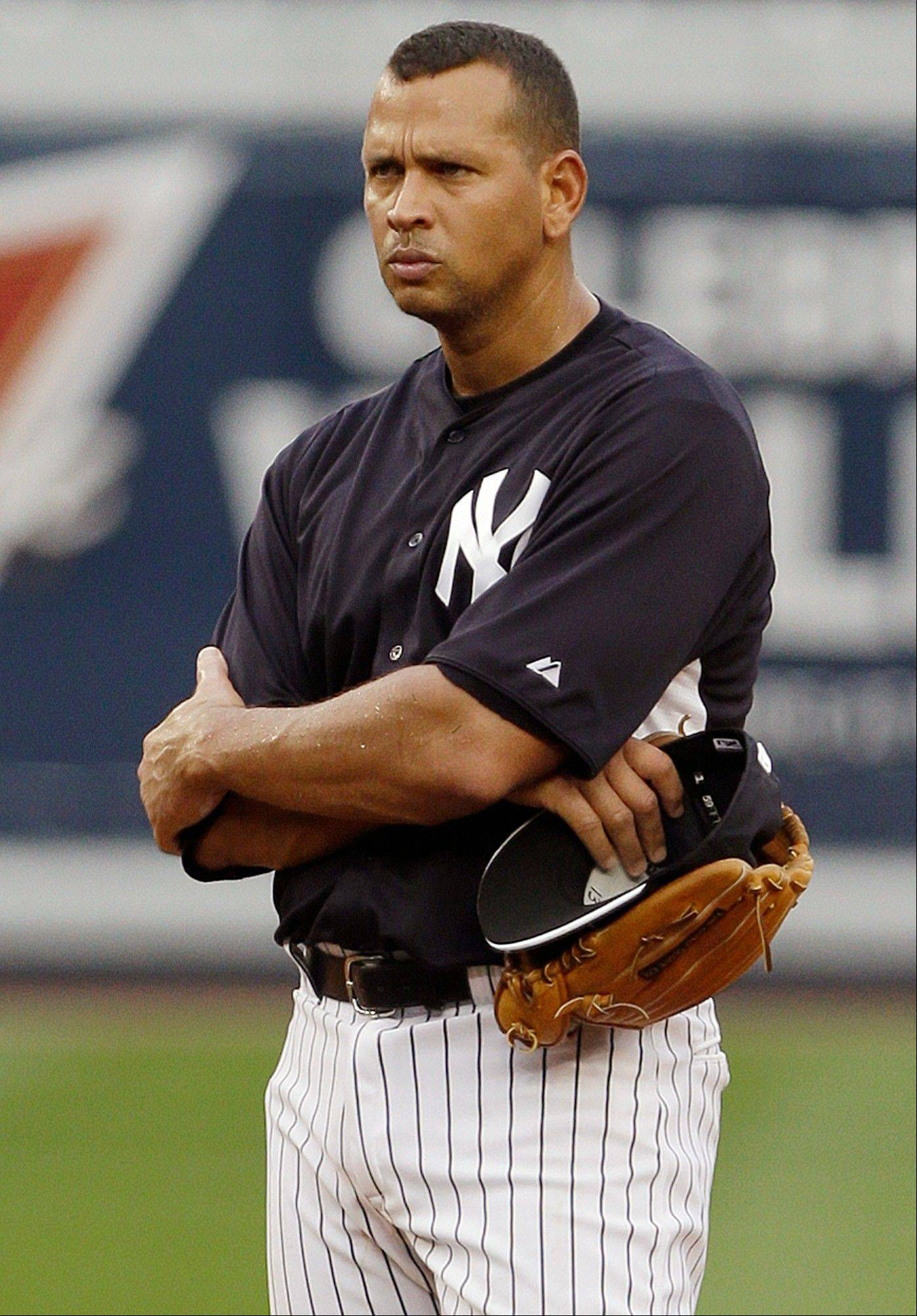 New York Yankees' Alex Rodriguez stands on the field during batting practice before a baseball game against the Detroit Tigers on Friday, Aug. 9, 2013, in New York. (AP Photo/Frank Franklin II)