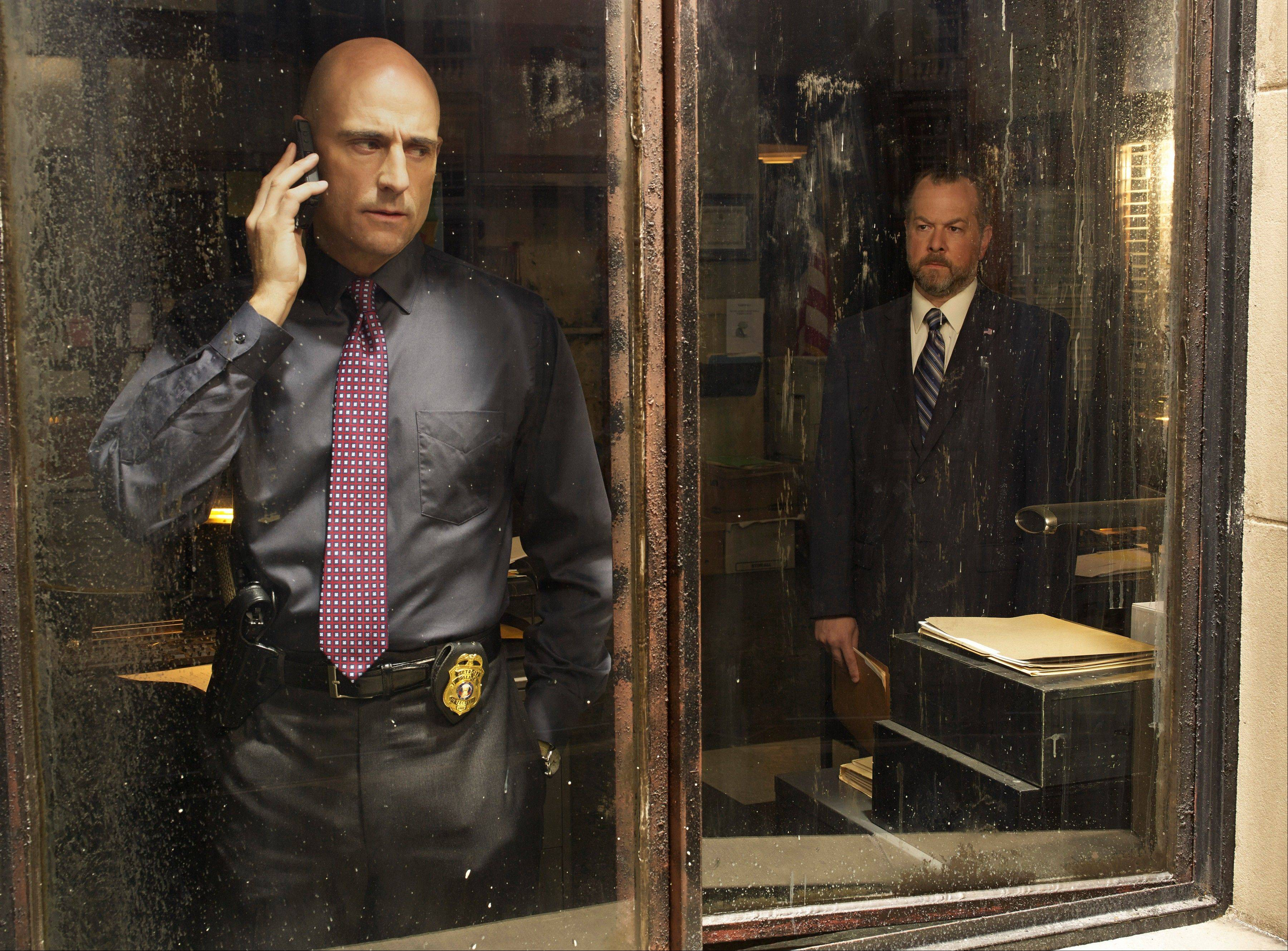 "Frank Agnew (Mark Strong) is dogged by Simon Boyd (David Costabile) for killing a fellow cop in AMC's ""Low Winter Sun."""