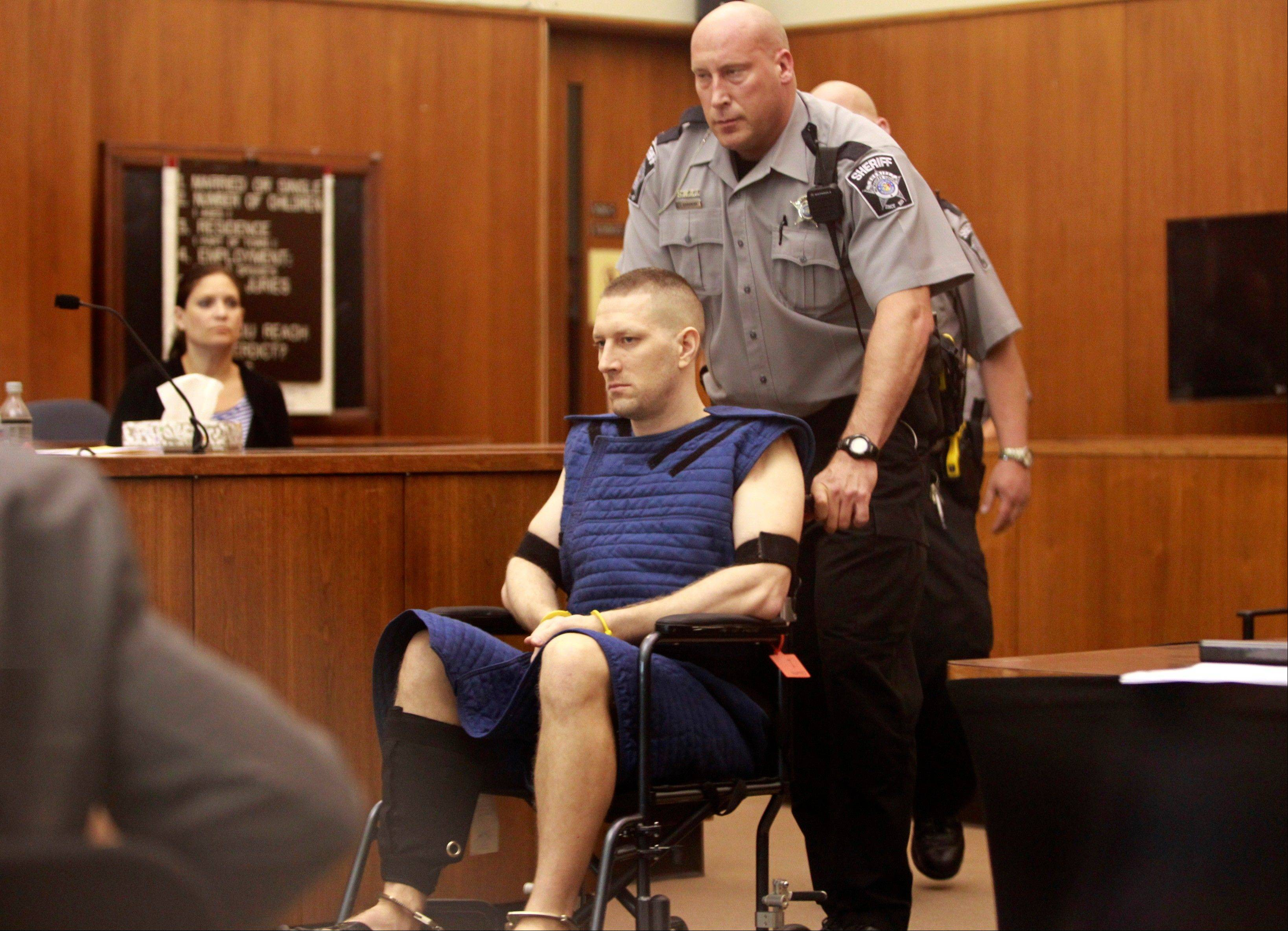 Benjamin G. Sebena is led into the courtroom on Friday in Milwaukee.
