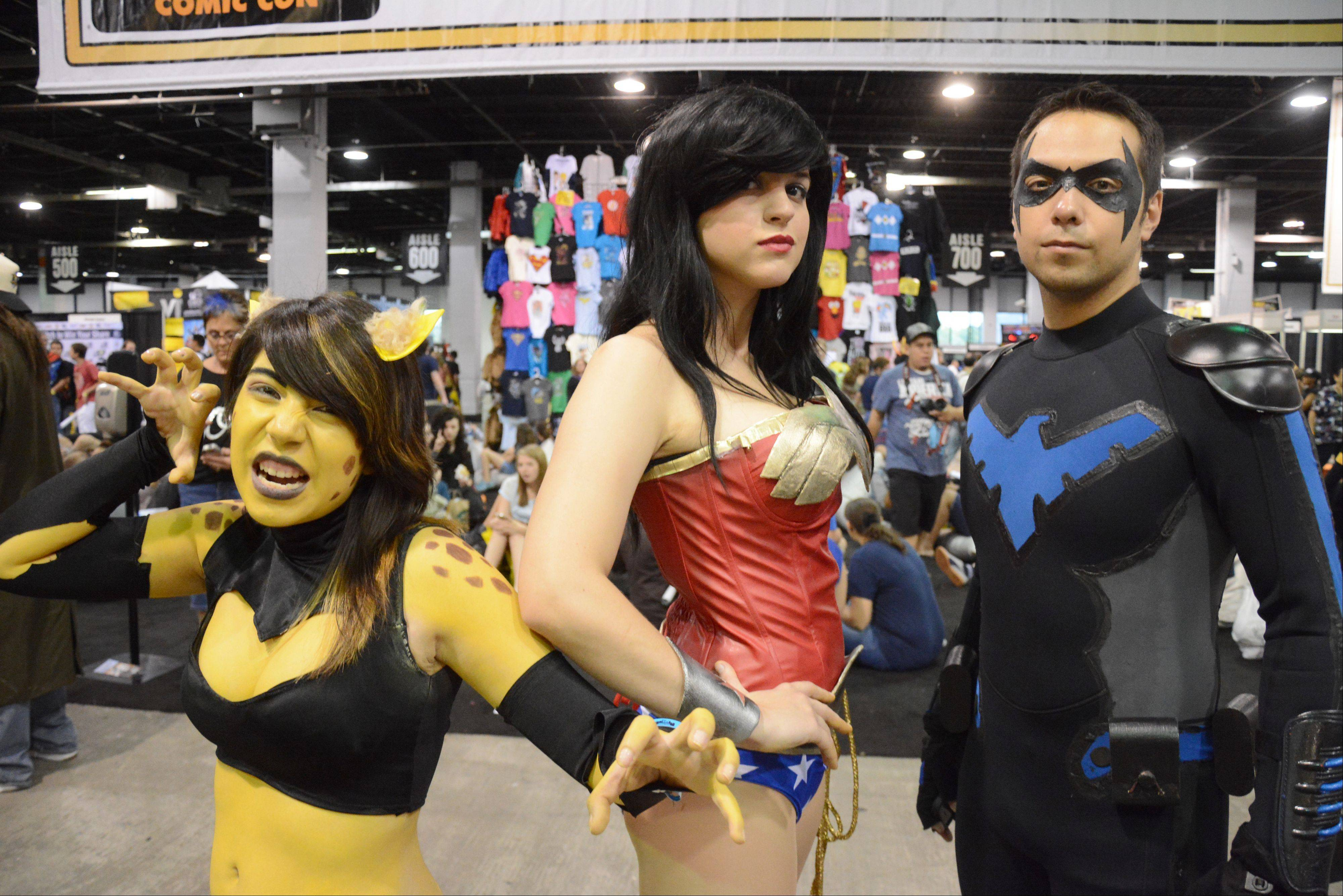 From left, Alexandra Vasquez, Bevan Sukowaty, and Dante Drake, all of Chicago, dressed up as various comic book characters.