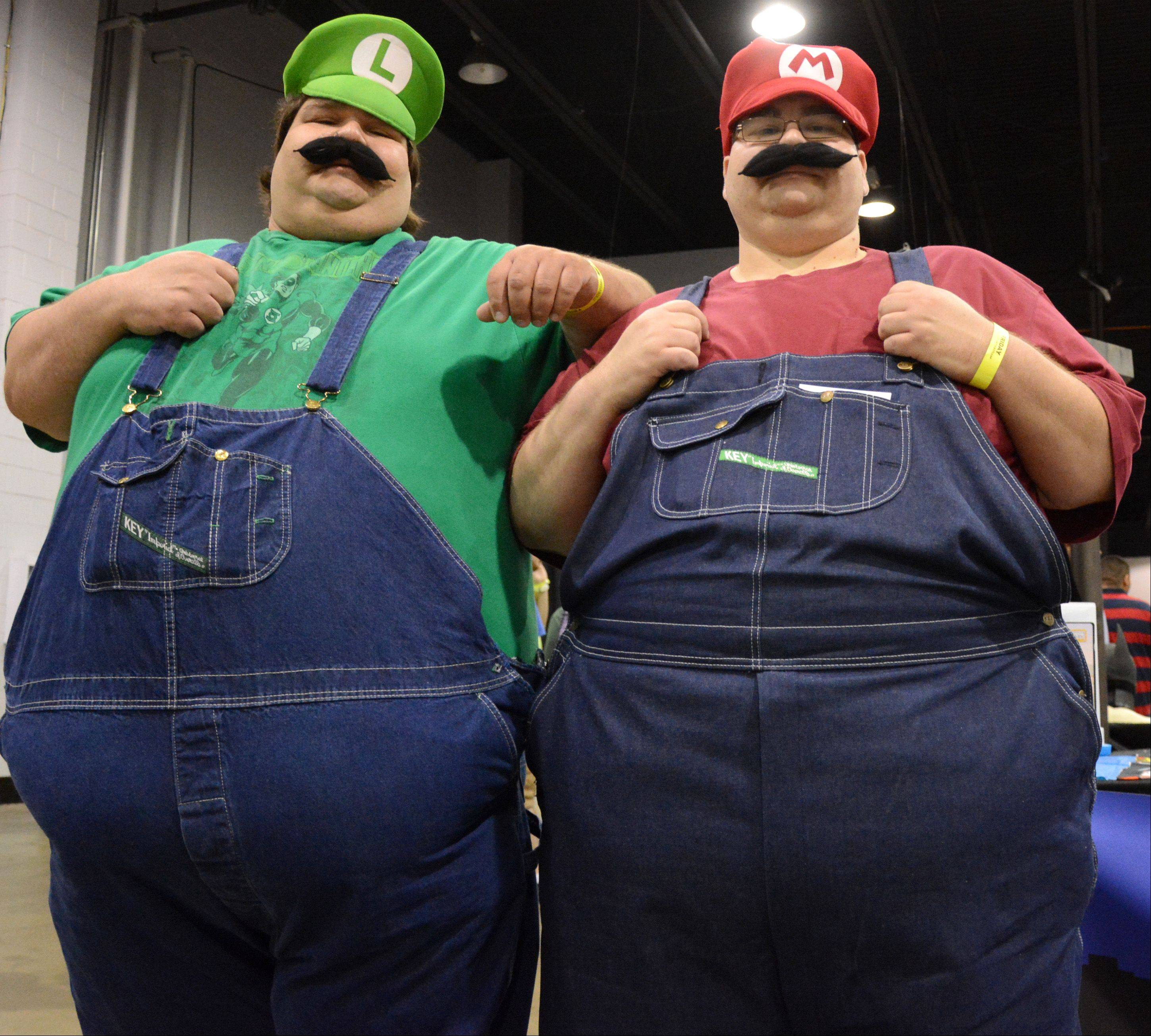 Sal Urso, left, and brother Dominico, both of Chicago, dress up as Mario and Luigi at Comic Con held at the Donald E. Stephens Convention Center in Rosemont Friday, August 9.