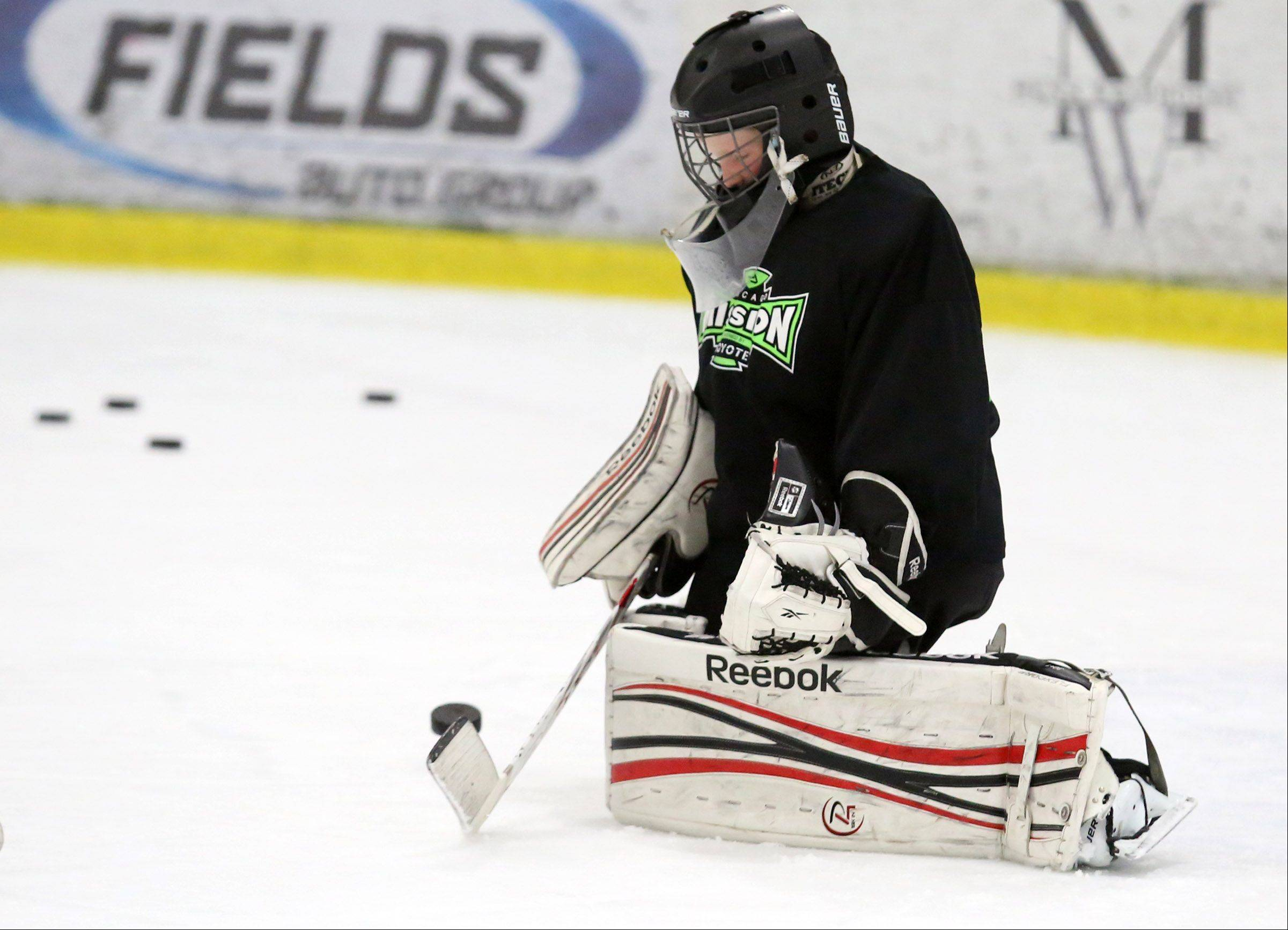 Goalie Jesse Easterwood, 10, of Chicago, blocks shots during a hockey camp Friday at Glacier Ice Arena in Vernon Hills.
