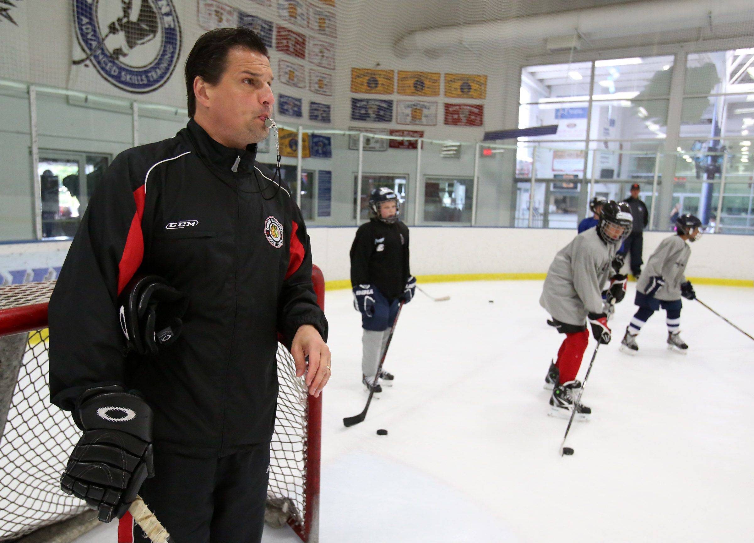 PeWee and Bantam boys receive instruction Friday from Chicago Blackhawks television analyst Eddie Olczyk at hockey camp Friday at Glacier Ice Arena in Vernon Hills.