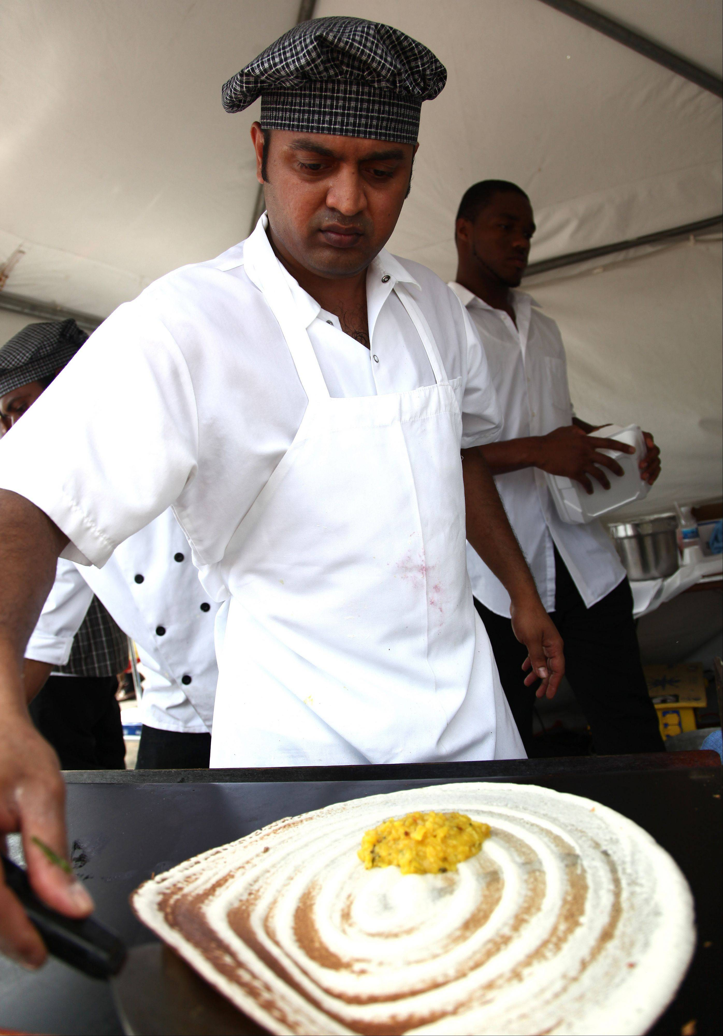 Vegetarian cooking demonstrations are a big draw at Veggie Fest, which runs 11 a.m. to 8 p.m. Saturday and Sunday at Science of Spirituality Meditation Center, 4S175 Naperville Road in Naperville. Here, Guru Prasad cooks up some Dosa in 2009.