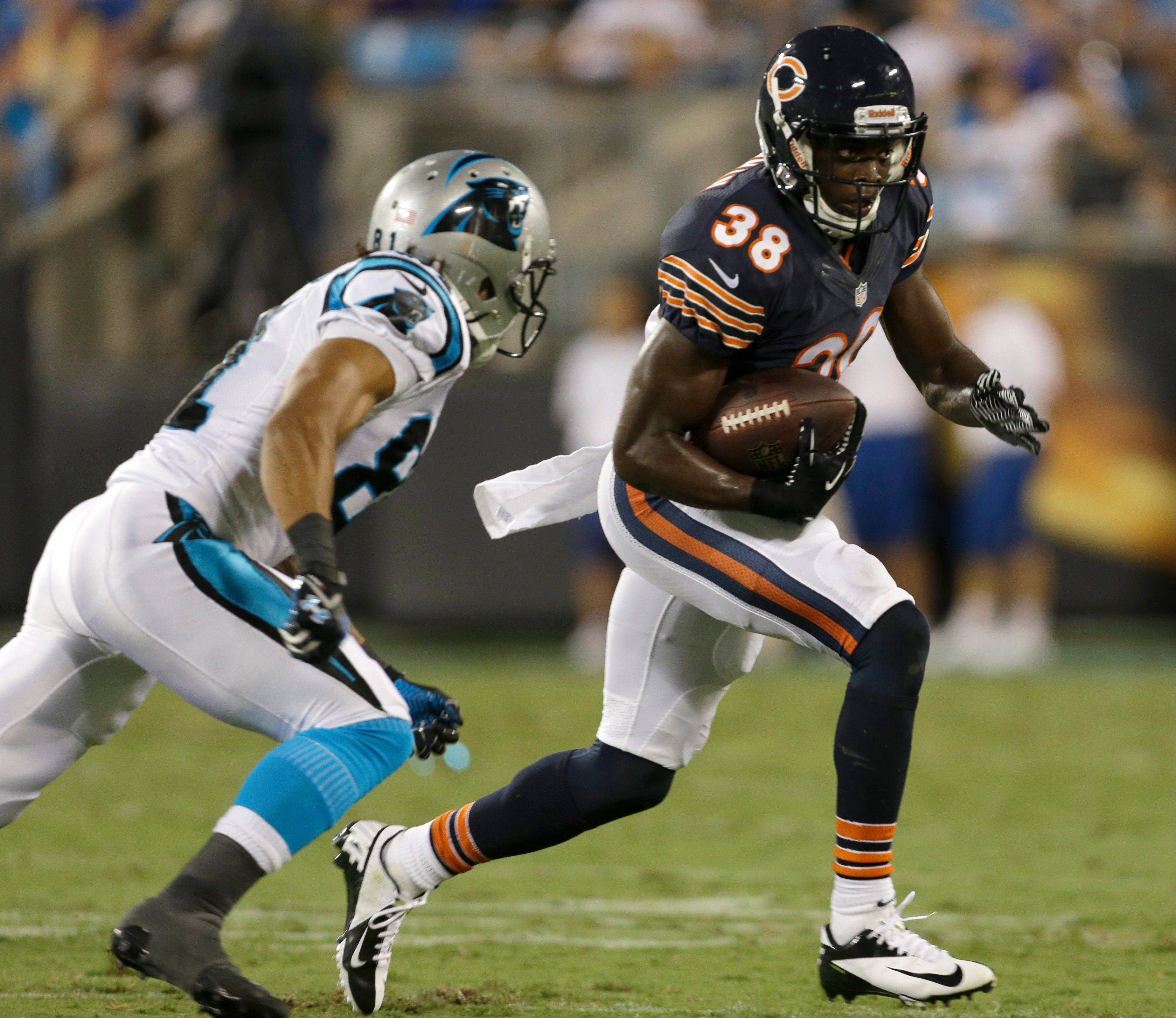 Chicago Bears' Zack Bowman (38) returns an interception against Carolina Panthers' Kealoha Pilares during the first half of a preseason NFL football game in Charlotte, N.C., Friday, Aug. 9, 2013.
