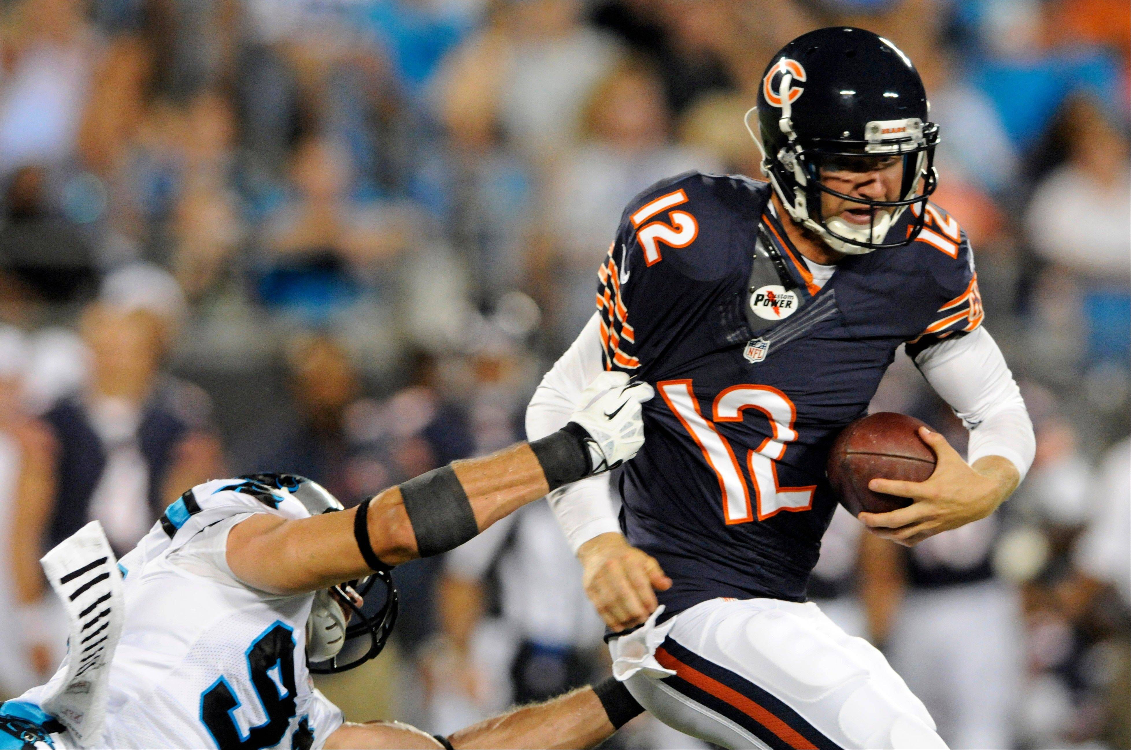 Chicago Bears quarterback Josh McCown (12) is sacked by Carolina Panthers' Colin Cole (91) during the first half of a preseason NFL football game in Charlotte, N.C., Friday, Aug. 9, 2013.