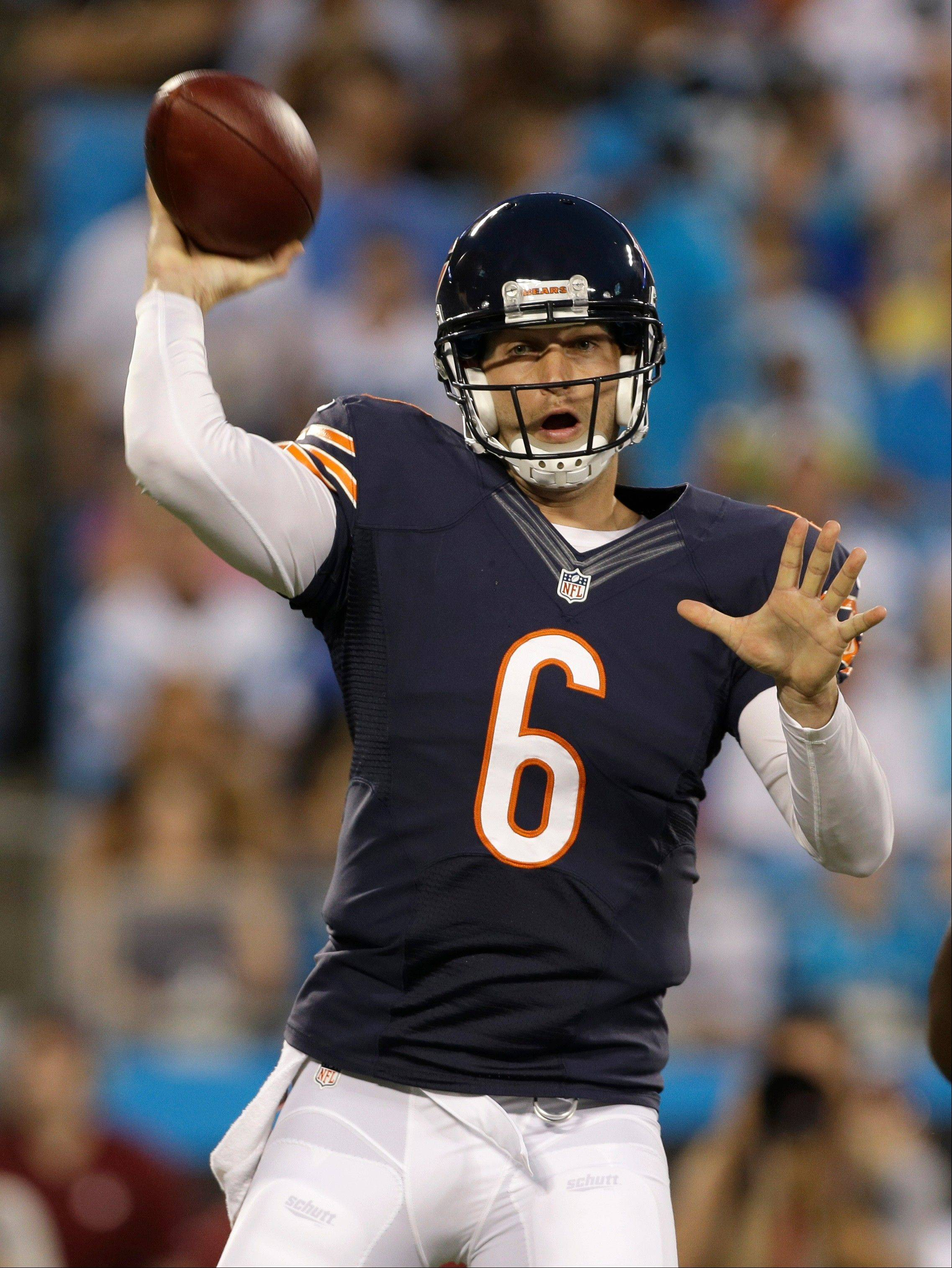 Chicago Bears quarterback Jay Cutler (6) throws a pass against the Carolina Panthers during the first half of a preseason NFL football game in Charlotte, N.C., Friday, Aug. 9, 2013.