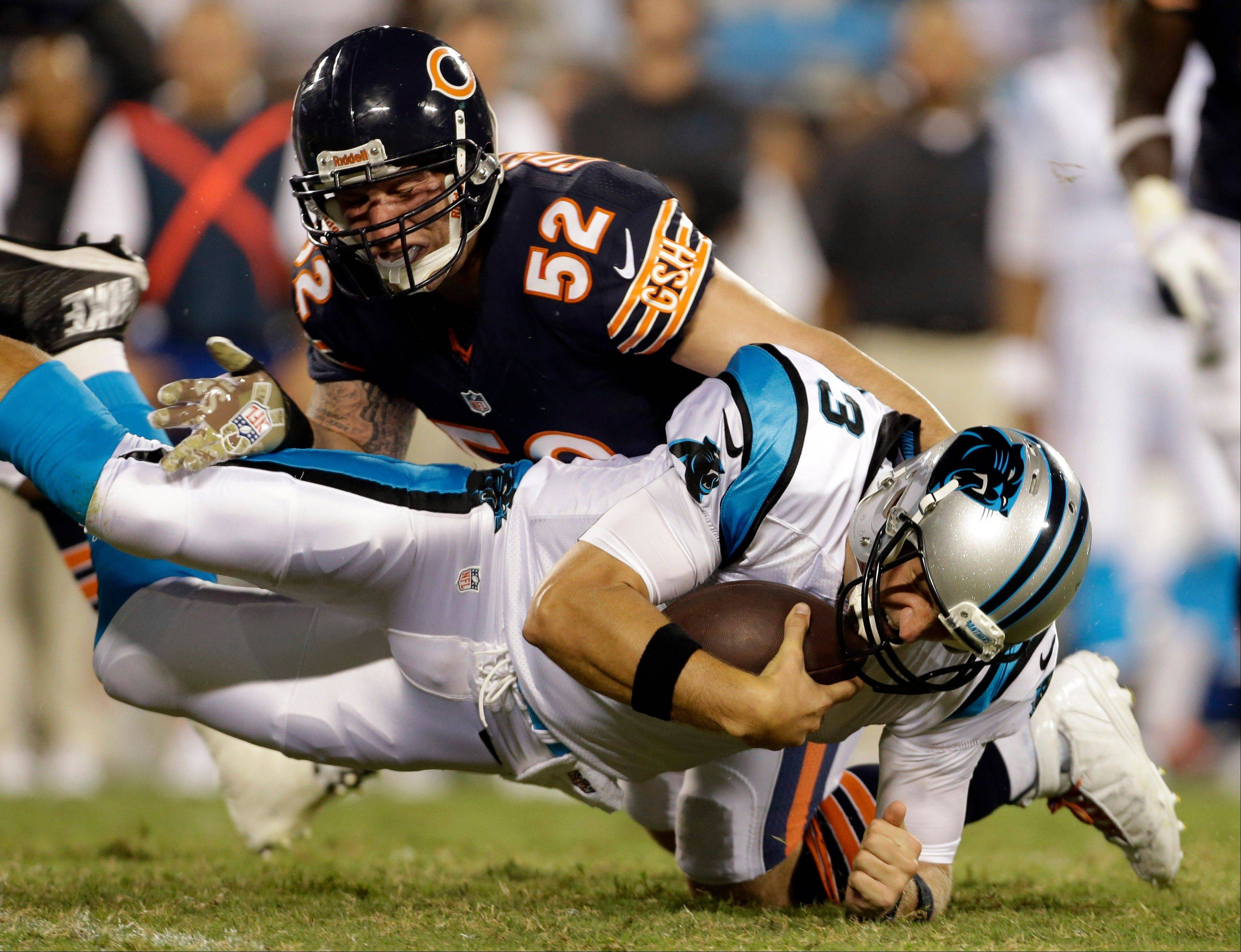 Carolina Panthers' Derek Anderson (3) is tackled by Chicago Bears' Blake Costanzo (52) during the first half of a preseason NFL football game in Charlotte, N.C., Friday, Aug. 9, 2013.