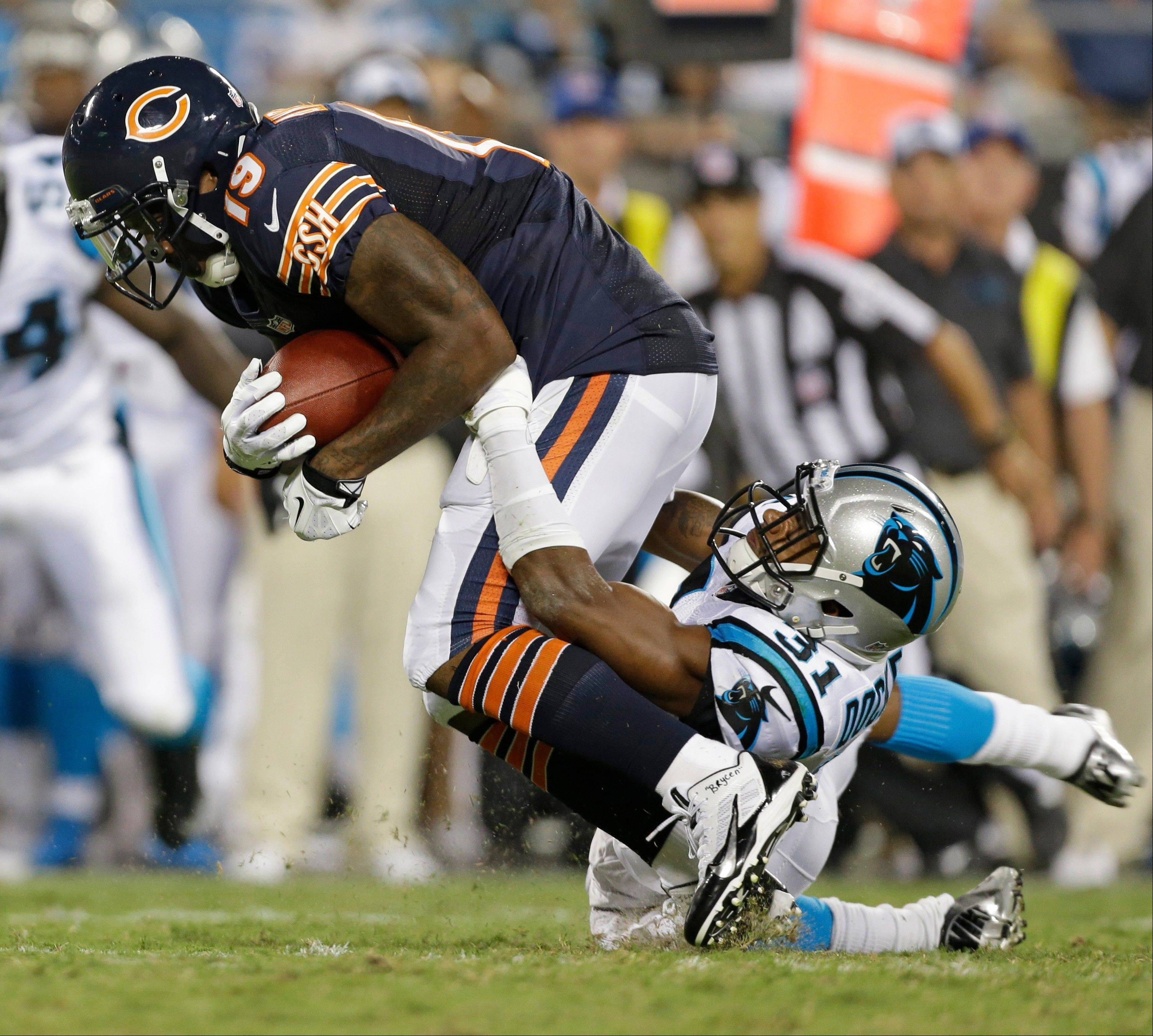 Chicago Bears' Joe Anderson (19) is pulled down by Carolina Panthers' James Dockery (31) during the first half of a preseason NFL football game in Charlotte, N.C., Friday, Aug. 9, 2013.