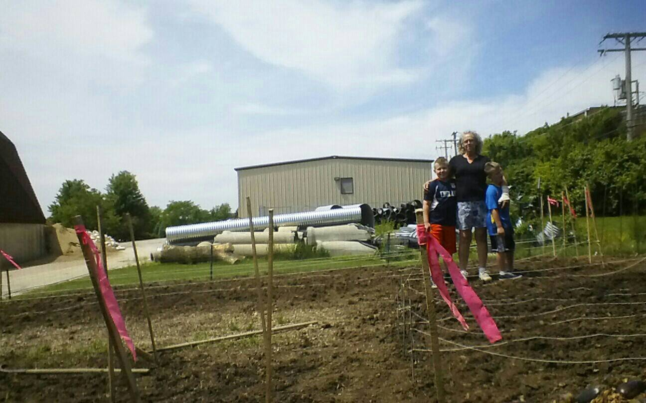 Nancy Tarulis and her two grandson's begin the task of starting a new garden for Lisle Township Food Pantry