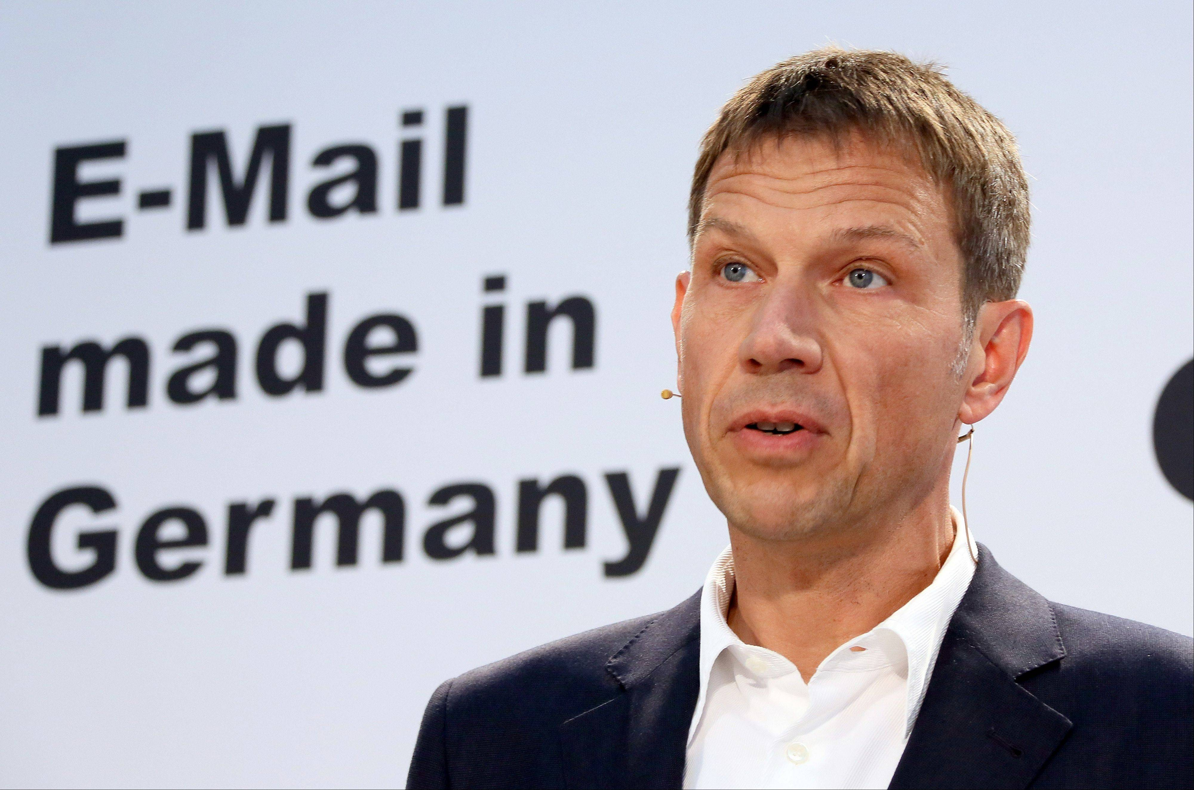 CEO of Deutsche Telekom Rene Obermann holds a press conference in Berlin Friday to discuss securing e-mail in Germany. Deutsche Telekom AG and United Internet AG, Germany's biggest Internet service providers, say they will encrypt customers' emails by default following reports that the U.S. National Security Agency monitors international electronic communications.