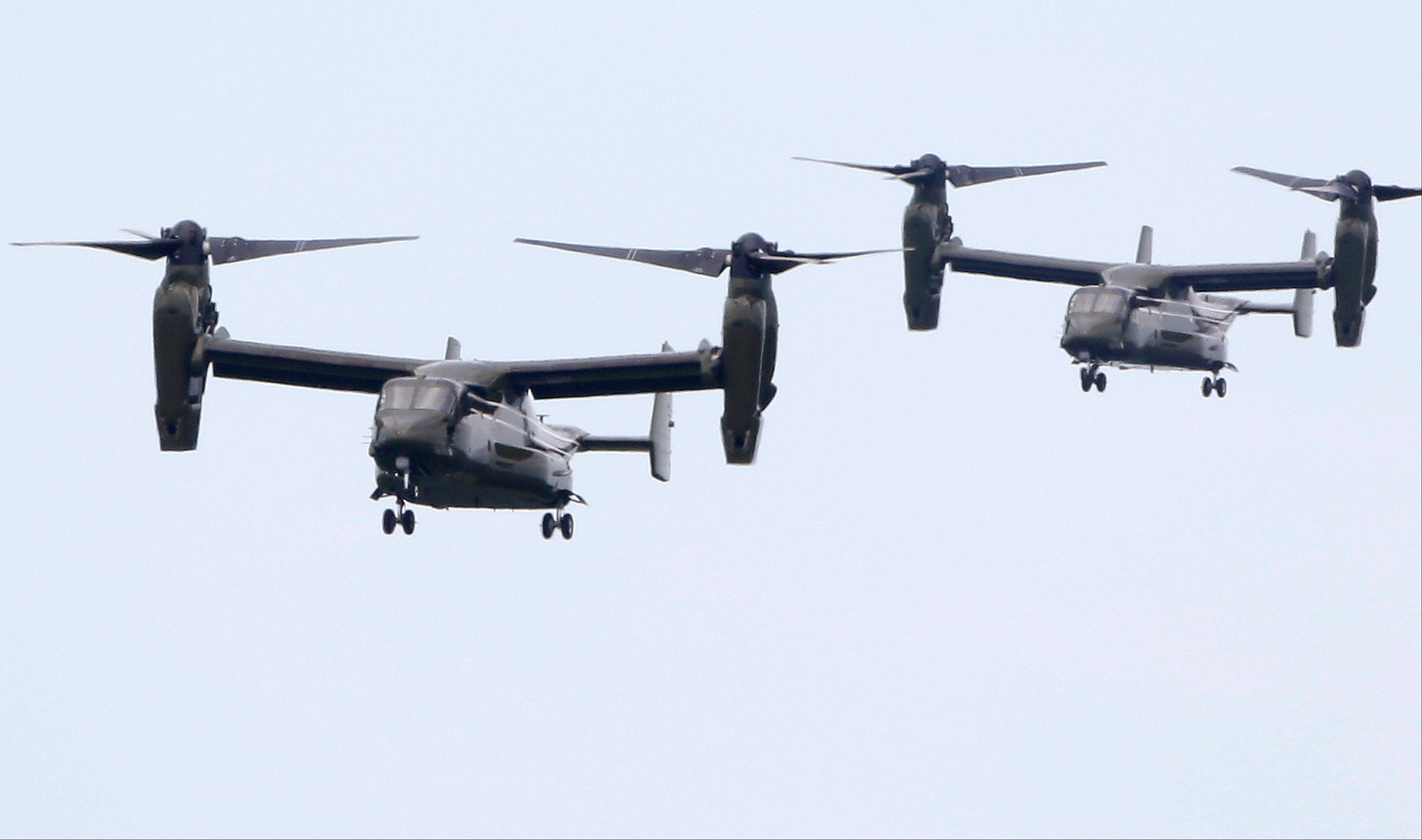 "Two MV-22 ""Osprey"" aircraft approach an airfield Saturday in Edgartown, Mass. on the island of Martha's Vineyard while flying in support of the Marine One helicopter carrying President Obama to the island."
