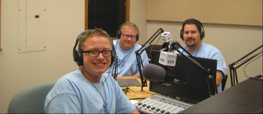 "Michael Geheren, left, his father, Bill, and Travis Wittmeyer run a Huntley Community Radio show called ""2 Dudes and a Dog"" that streams online. Michael Geheren is its executive producer, while his father and Wittmeyer are the hosts."