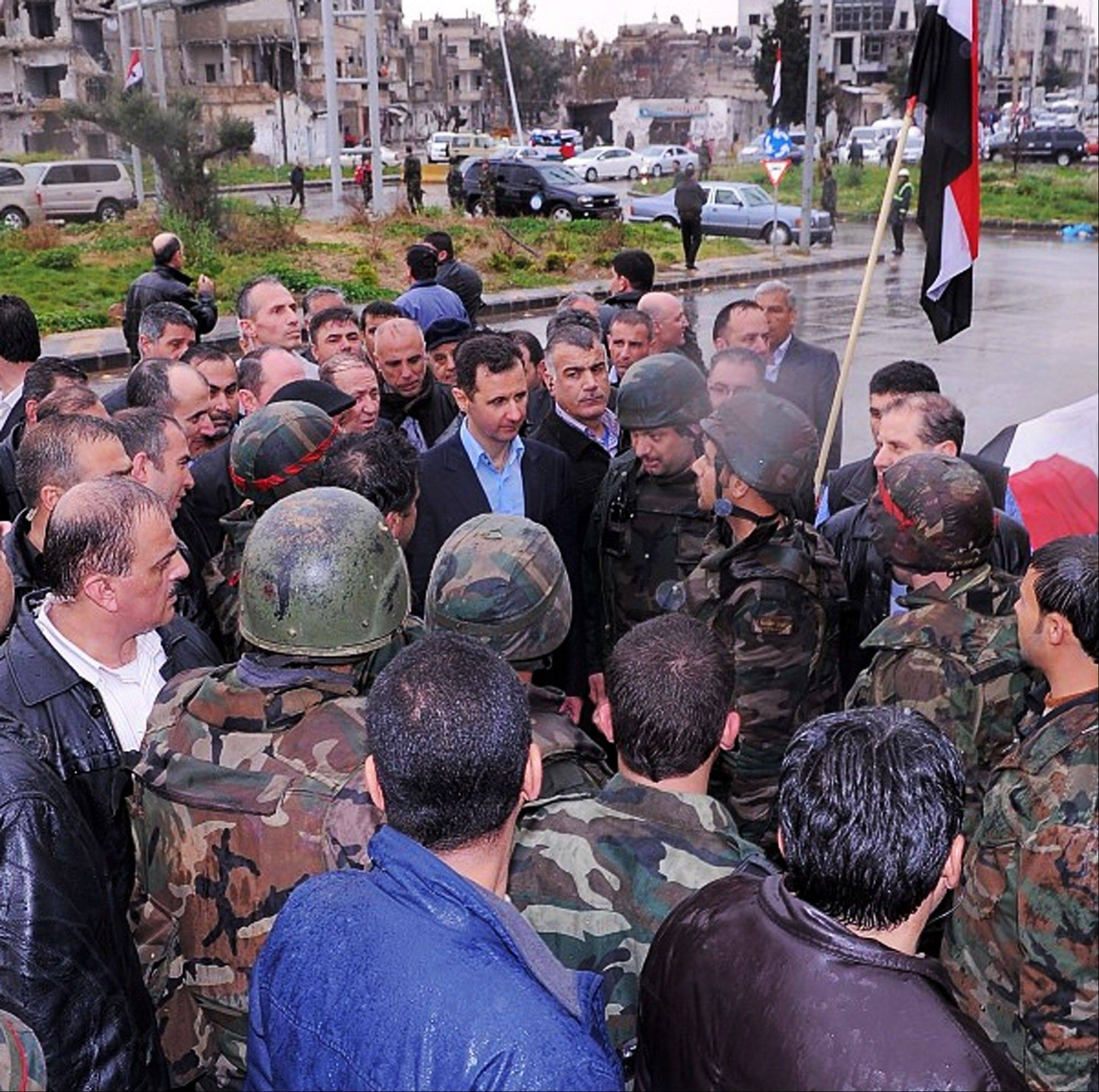 This undated photo posted on the official Instagram account of the Syrian Presidency purports to show Bashar Assad visiting with soldiers in Baba Armr, Homs province, Syria, in 2012. Amid the carnage from the Syrian civil war, President Bashar Assad has embraced every tool at his disposal including social media to project confidence and transmit his message to dedicated fans, most recently on the popular photo-sharing service Instagram posting pictures of himself and his glamorous wife surrounded by idolizing crowds.