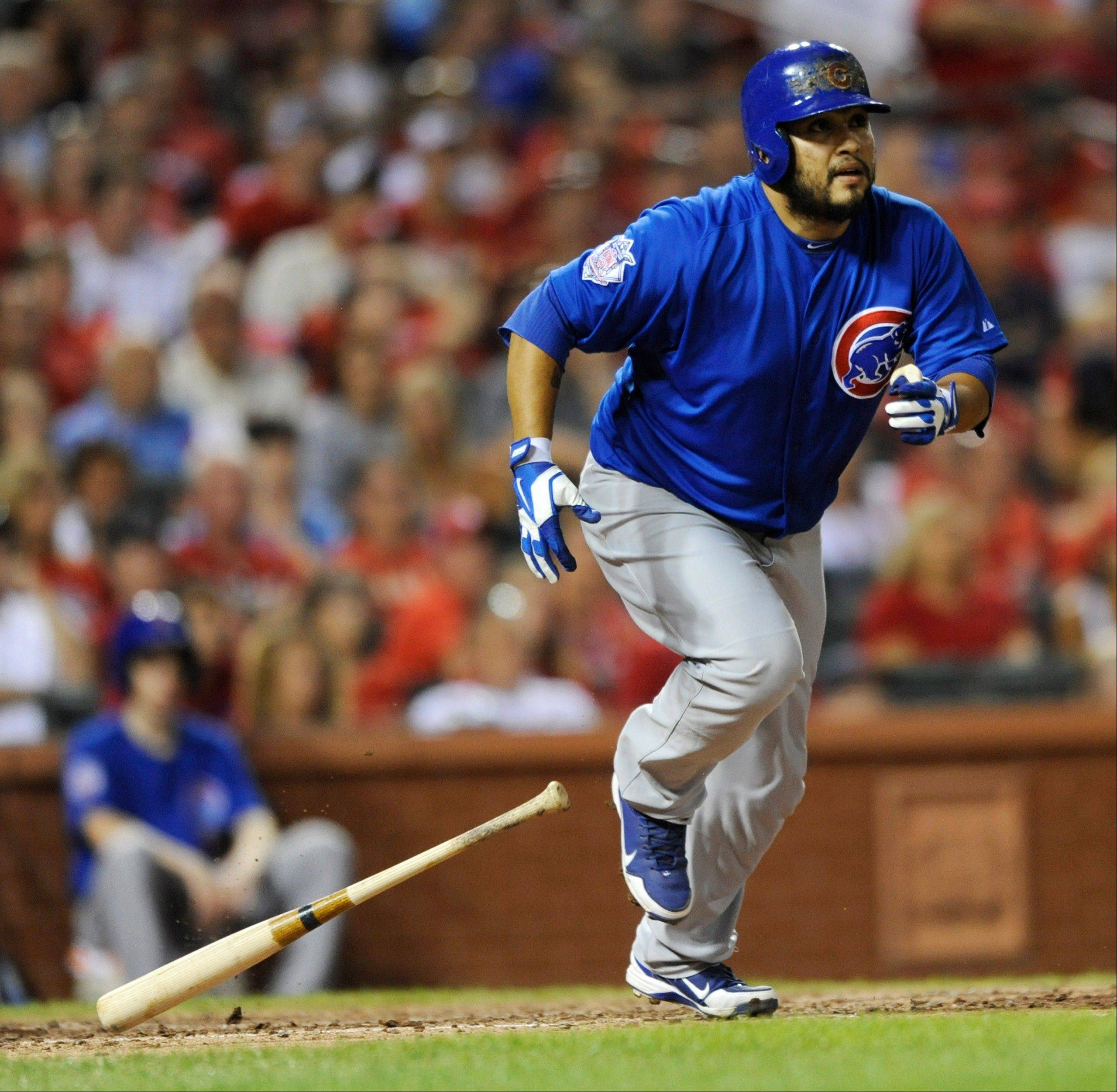 The Cubs' Dioner Navarro watches his RBI double against the St. Louis Cardinals during the eighth inning Saturday night at Busch Stadium in St. Louis.