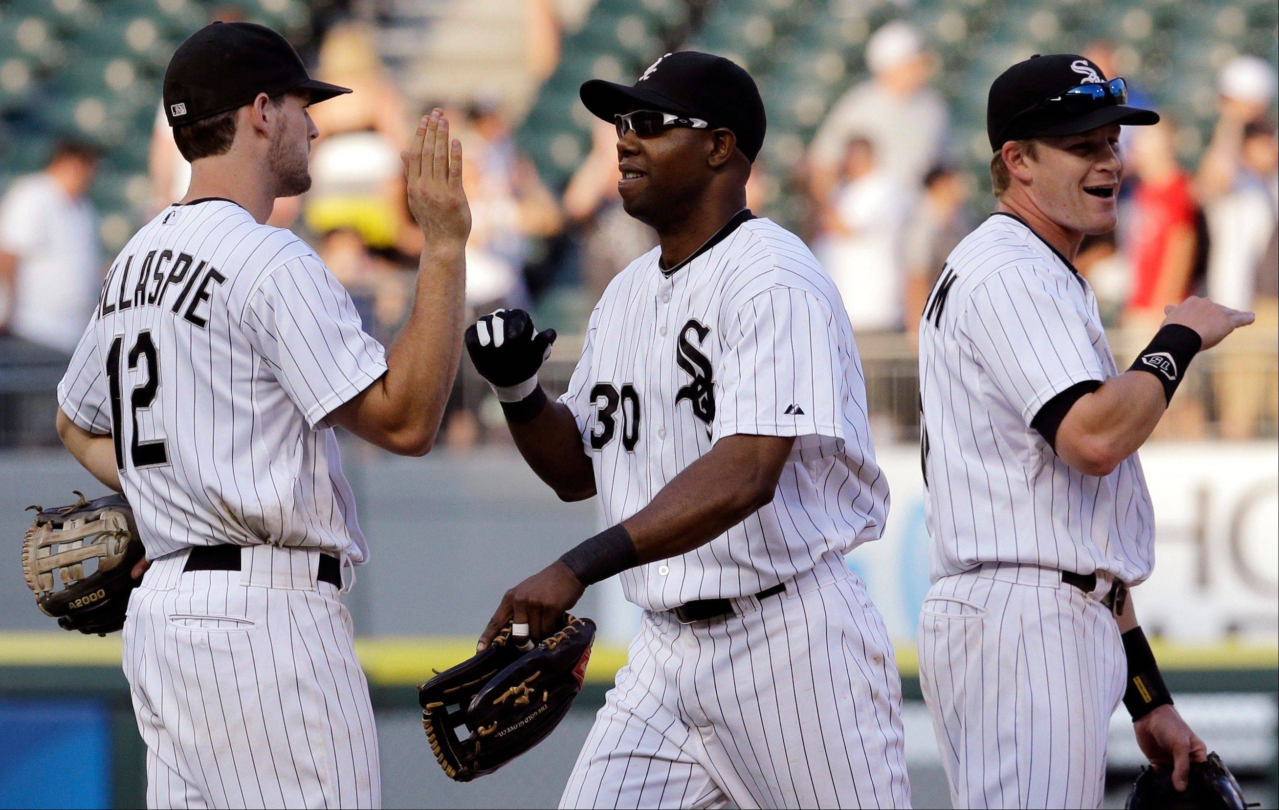 White Sox left fielder Alejandro De Aza, middle, celebrates with teammates Conor Gillaspie, left, and Gordon Beckham after Saturday�s 5-4 victory over the Minnesota Twins at U.S. Cellular Field.