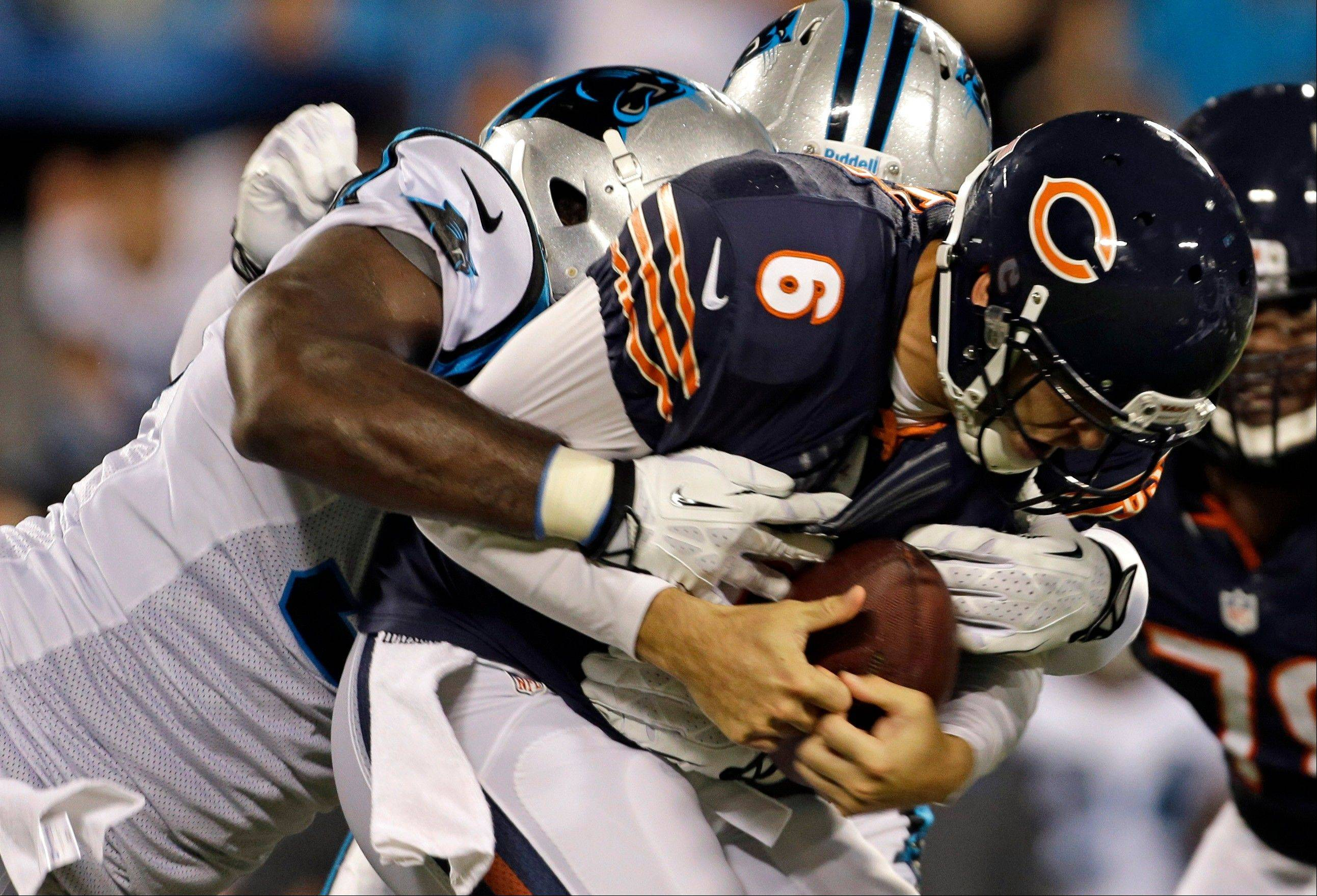 Bears quarterback Jay Cutler (6) is sacked by Carolina Panthers' Charles Johnson, left, during the first half of a preseason NFL football game in Charlotte, N.C., Friday, Aug. 9, 2013. (AP Photo/Bob Leverone)