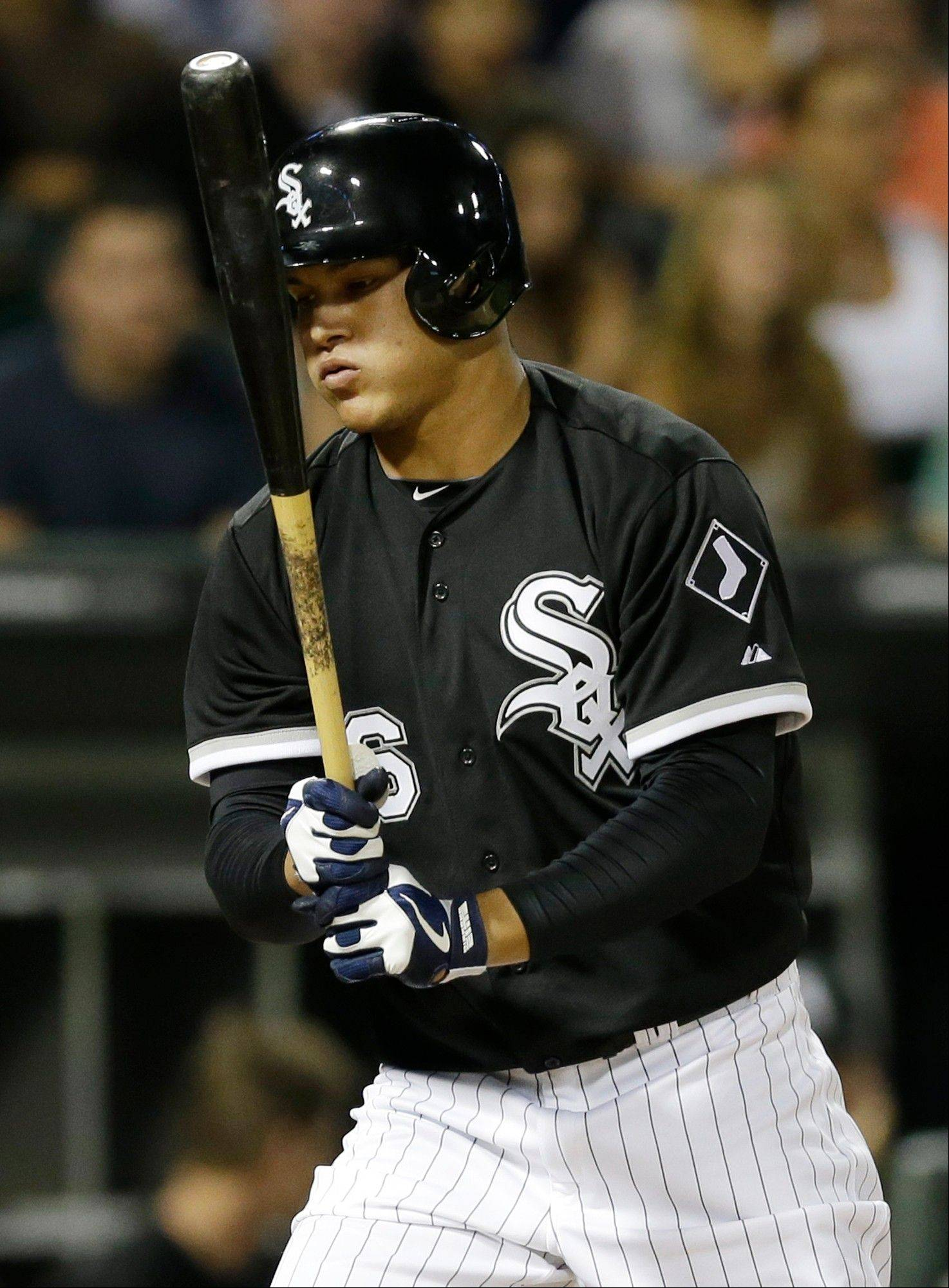 Avisail Garcia reacts after striking out in his first at-bat with the White Sox during the seventh inning of the second game Friday night against the Twins at U.S. Cellular Field.