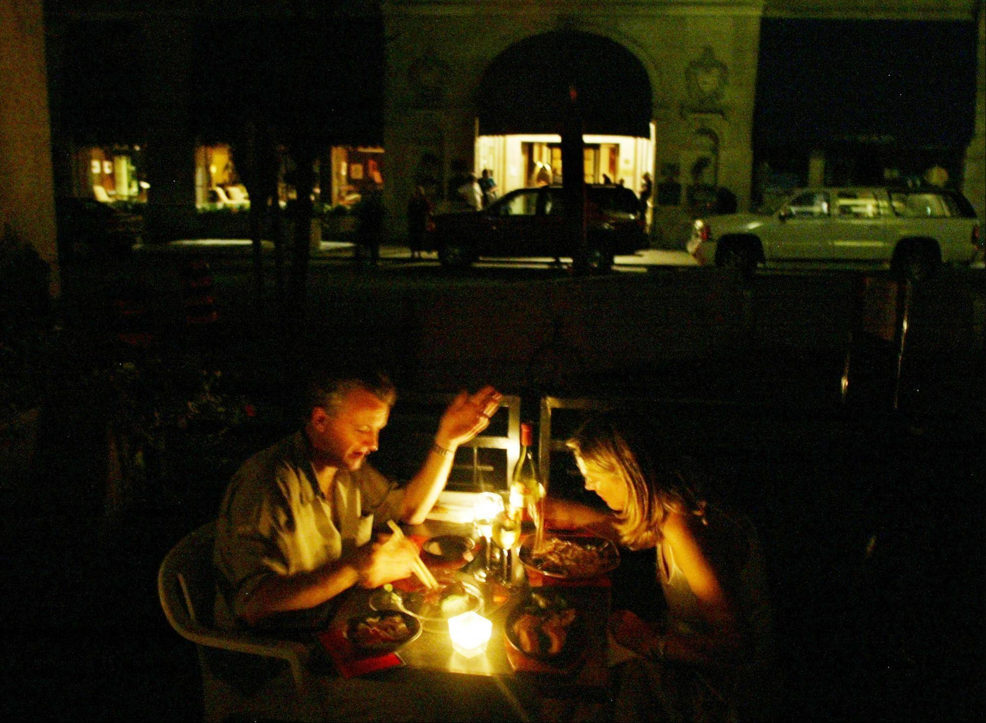A couple enjoy a candlelight dinner at a downtown Toronto restaurant during a major power failure.