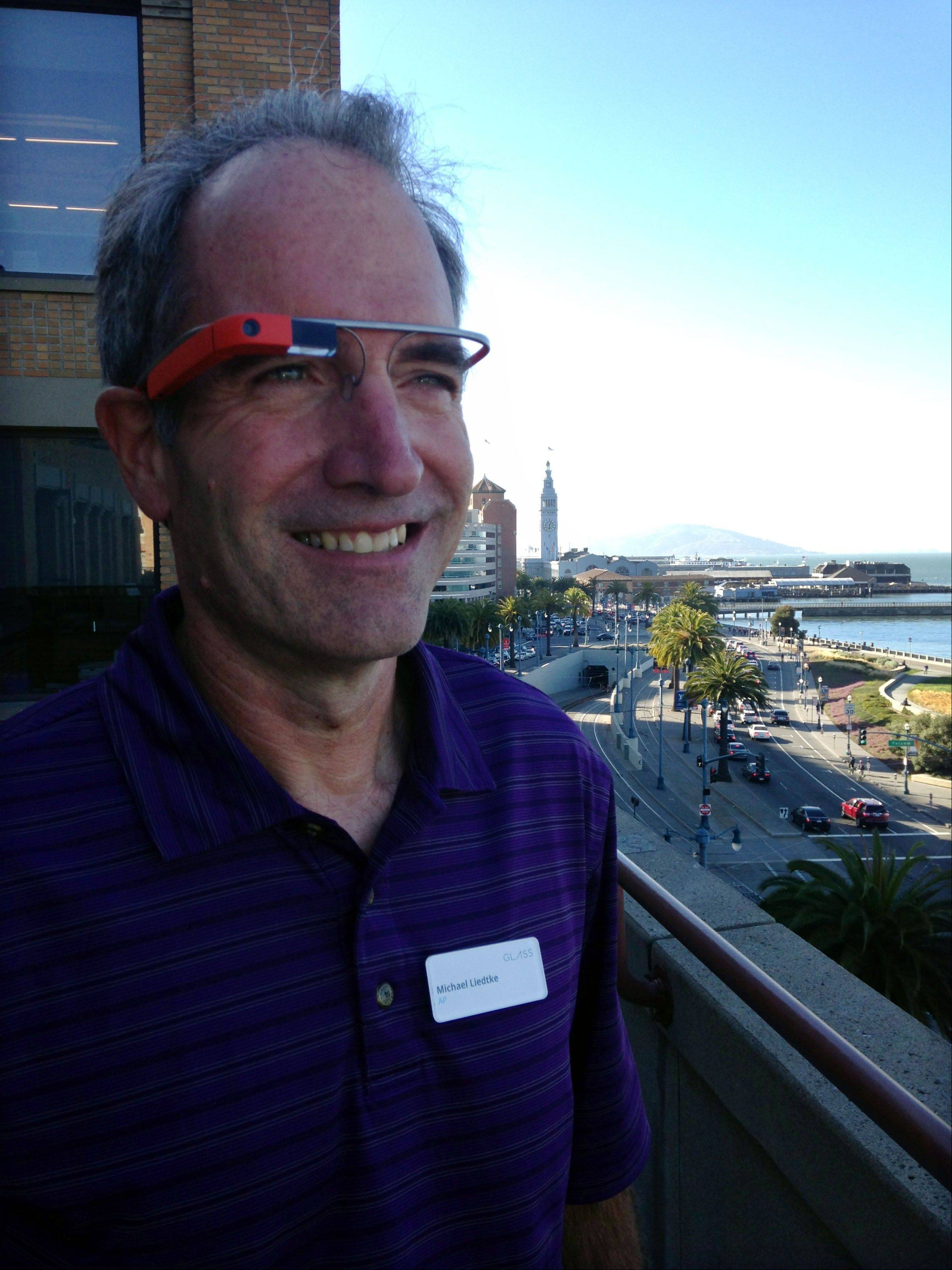 Associated Press reporter Michael Liedtke models Google glass at a Google base camp in San Francisco. Google Inc. is touting Glass as a liberating breakthrough that will make technology more convenient and less obnoxious in social situations than checking a smartphone to see what's happening in your digital realm. Critics deride Glass as another disturbing example of a how enslaved people are to their devices and a sign that technology is obliterating personal privacy.