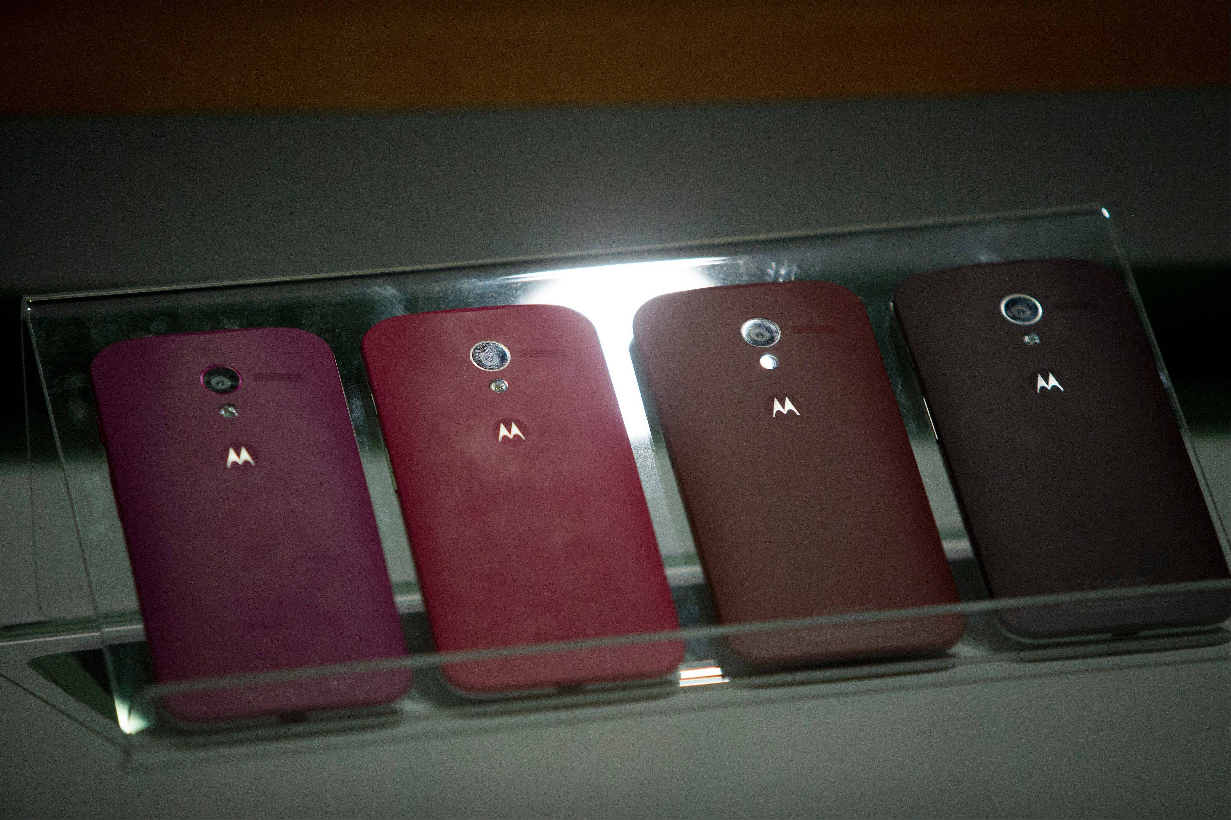 The Motorola Mobility Moto X phone is displayed during a launch event in New York, U.S., on Thursday, Aug. 1, 2013. Google Inc.'s Motorola Mobility unit today announced a flagship Moto X smartphone with customizable colors, in an effort to revive the business after falling behind Apple Inc. and Samsung Electronics Co.