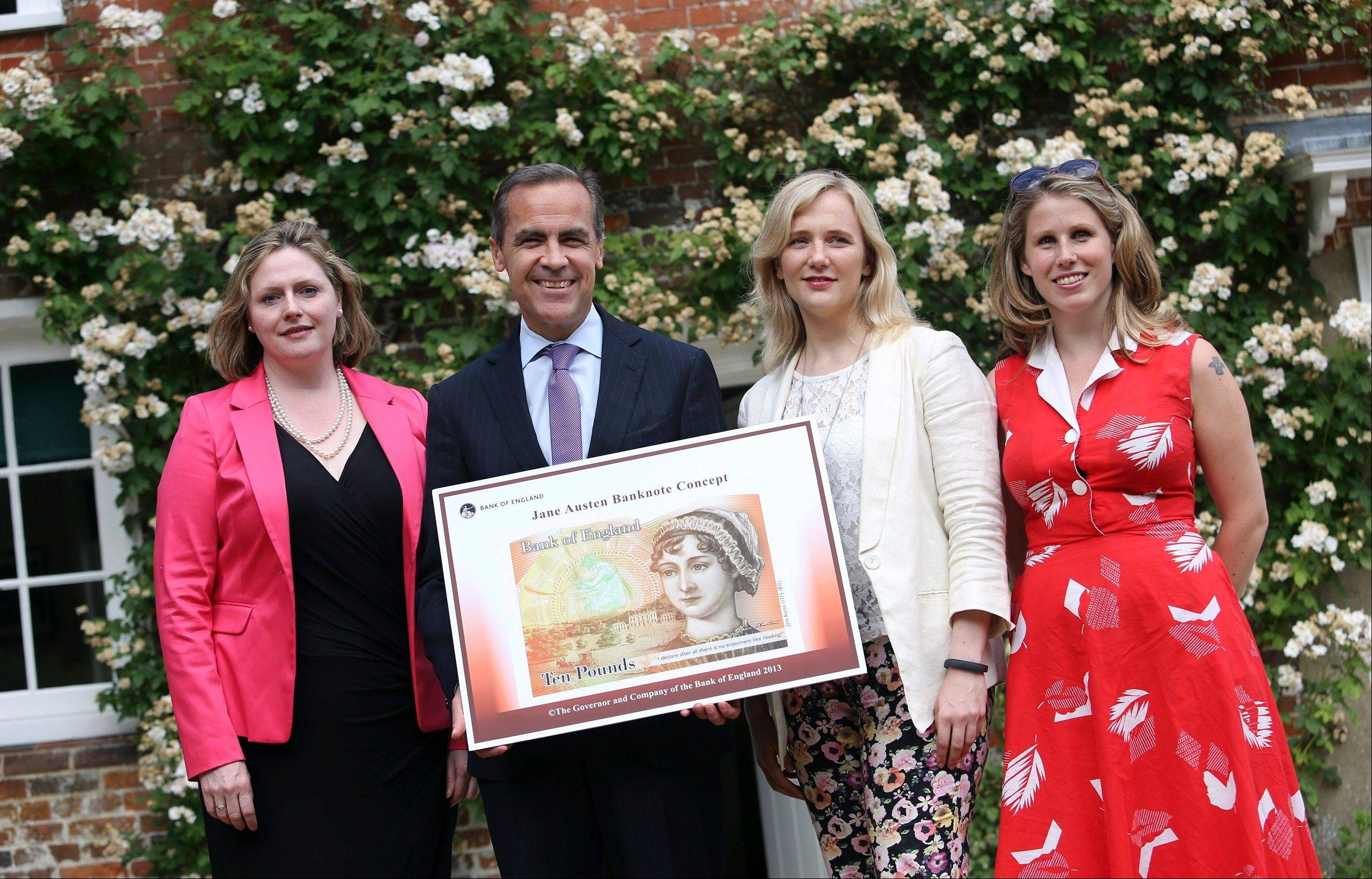 Caroline Criado-Perez, right, poses with a concept design for a 10-pound note adorned with an image of author Jane Austen. From left: Mary Macleod, conservative member of Parliament; Bank of England Governor Mark Carney; Stella Creasy, Labor member of Parliament.