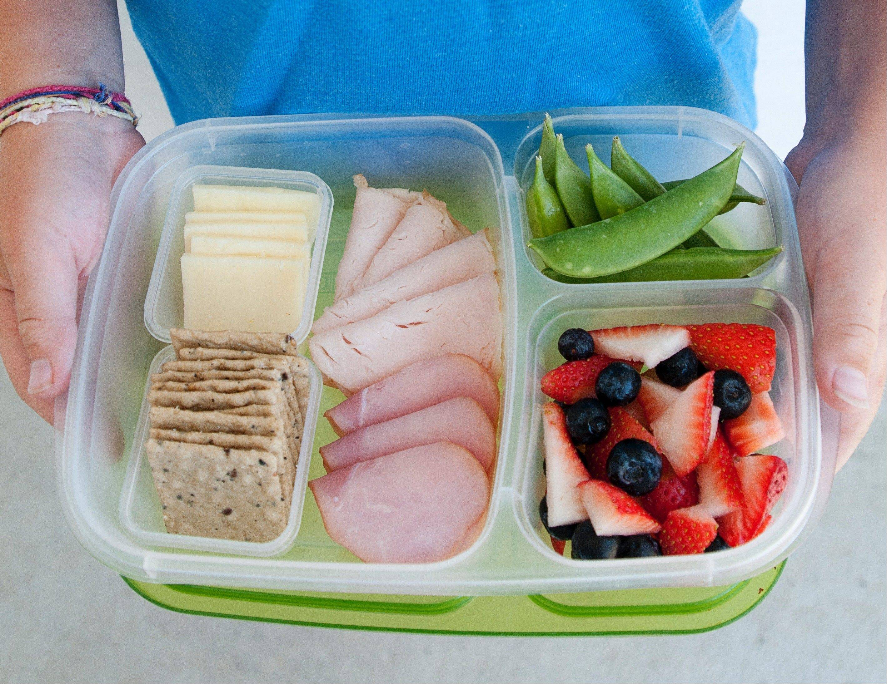 By using a separated container, it's easy to put together a Lunchable-style lunch with mom-approved foods.
