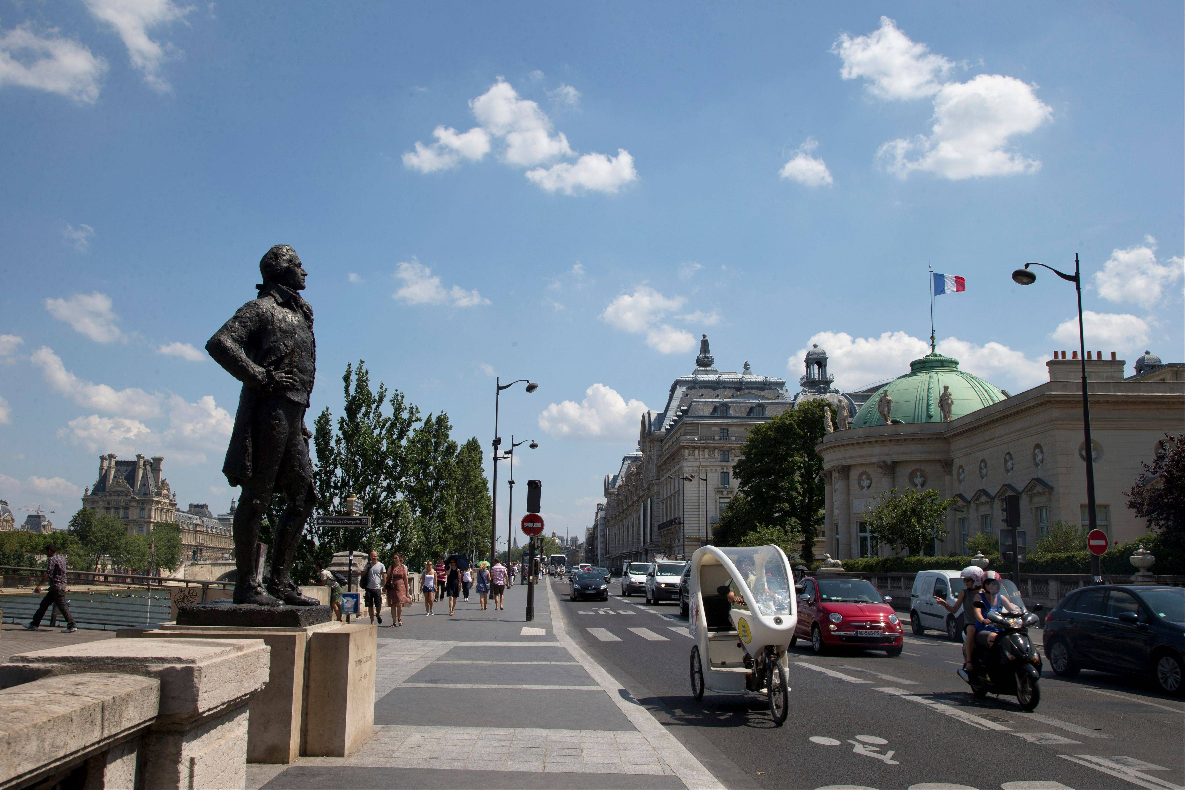 In this photo taken Friday, July 19, 2013, The Statue of Thomas Jefferson, faces the Legion of Honour building, right, in Paris. The building was the inspiration for Jefferson's Monticello house located just outside Charlottesville, Va.