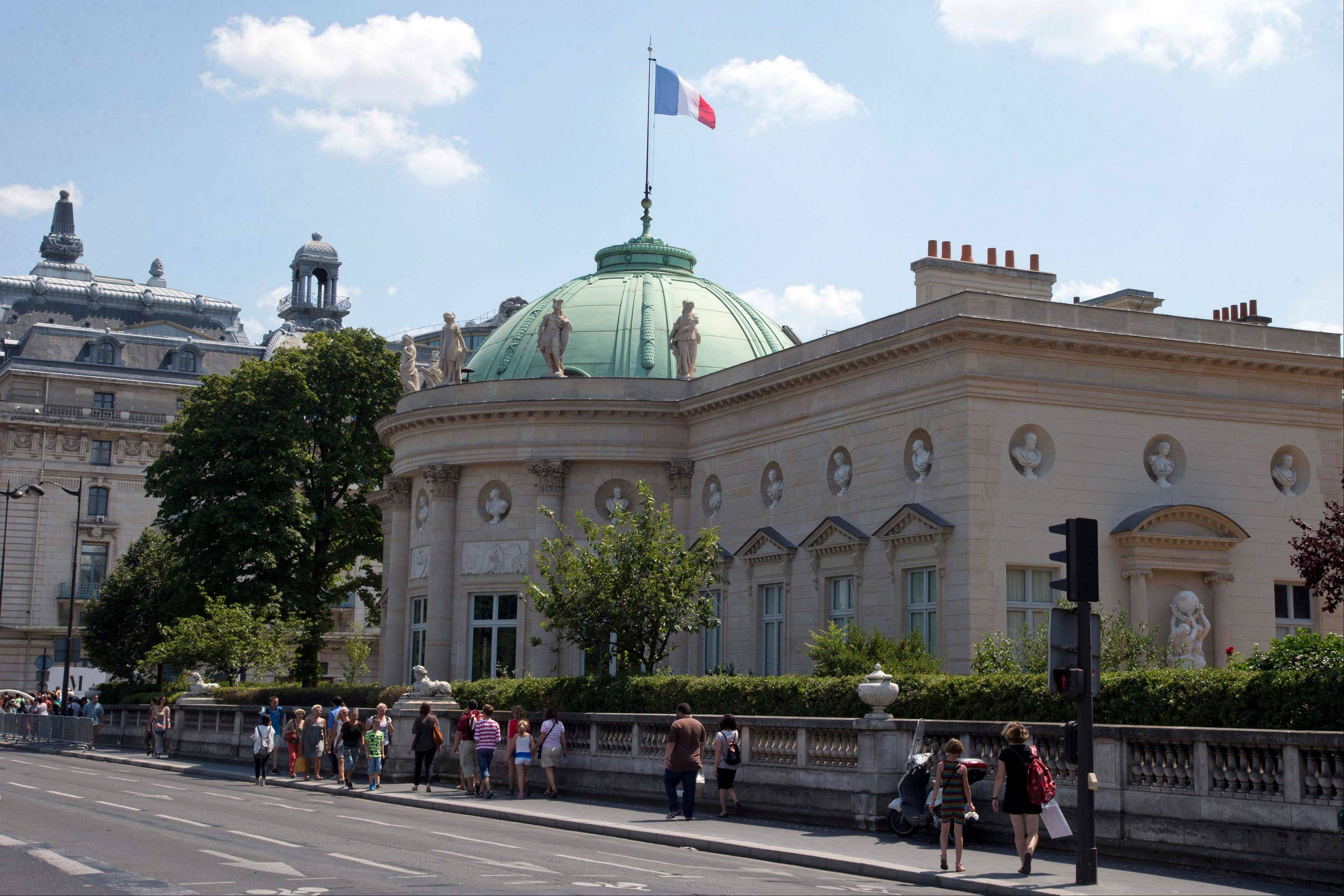 People walk in front of Legion of Honour building next to MusÈe d'Orsay during a guided tour in Paris. The building was the inspiration for Thomas Jefferson's Monticello house in Charlottesville, Va.