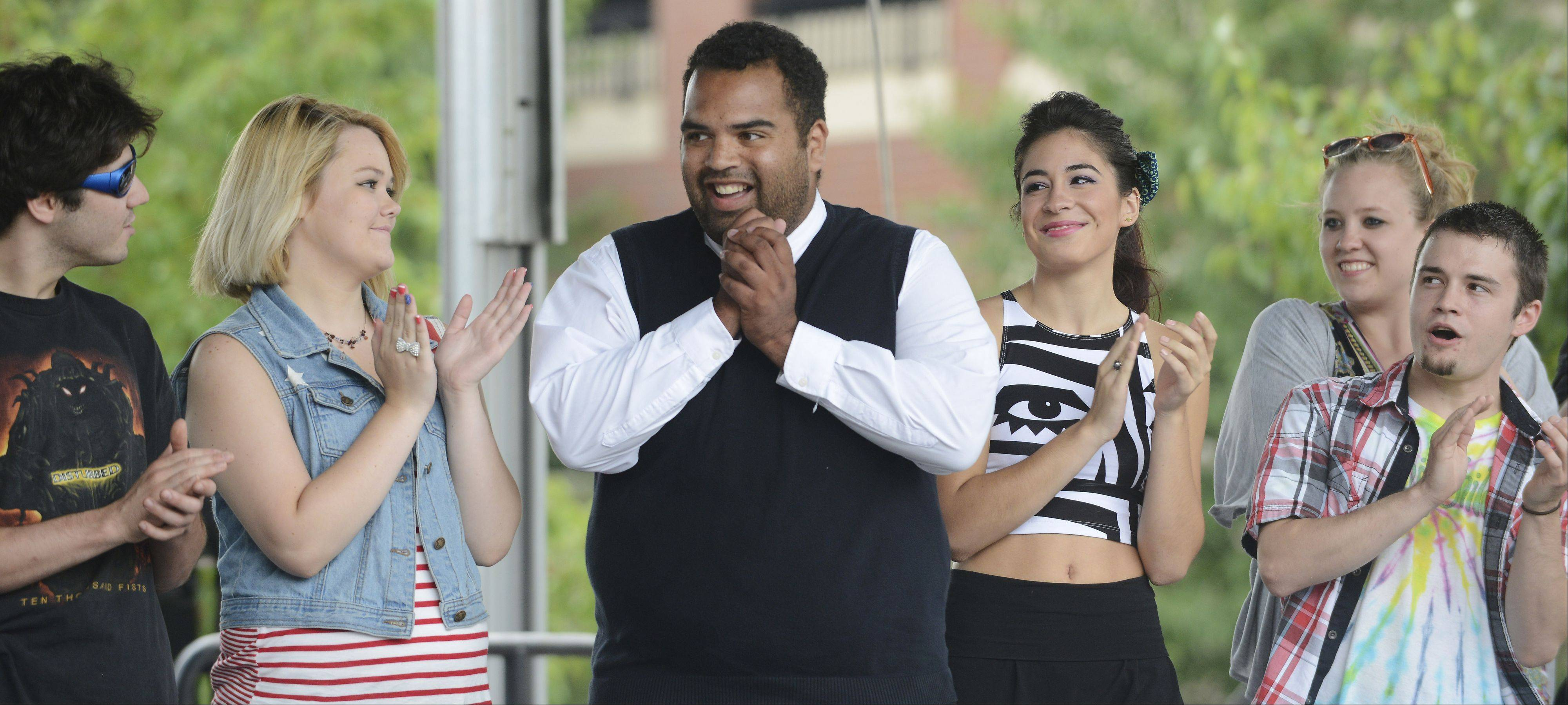 Andrew Johnston, center, reacts after being announced the Fan Favorite of Suburban Chicago's Got Talent in Arlington Heights Saturday.