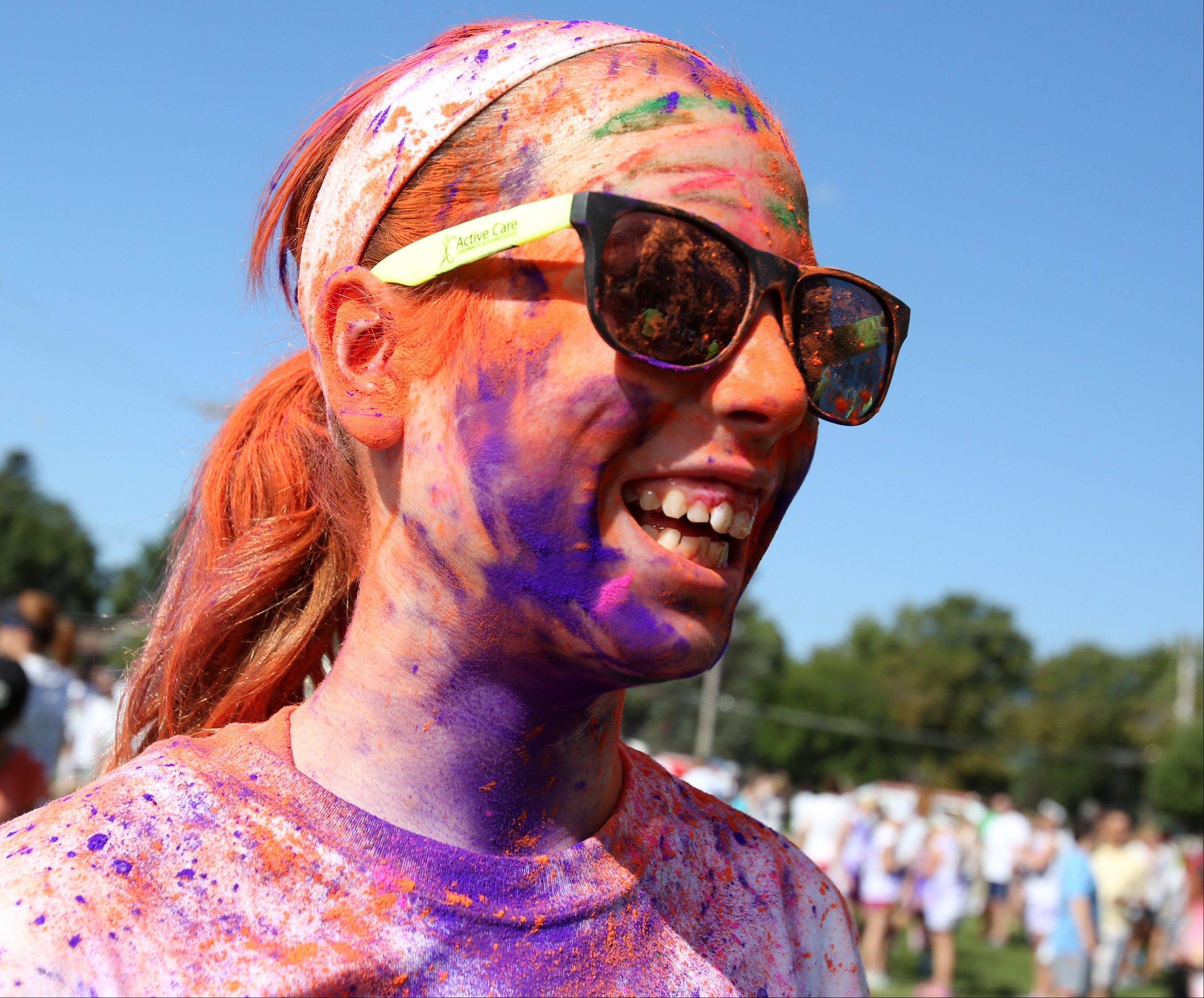 Paige Schulz, 13, Cary, was covered in colored power before the start of the first Active Care Color Blast 5K run.