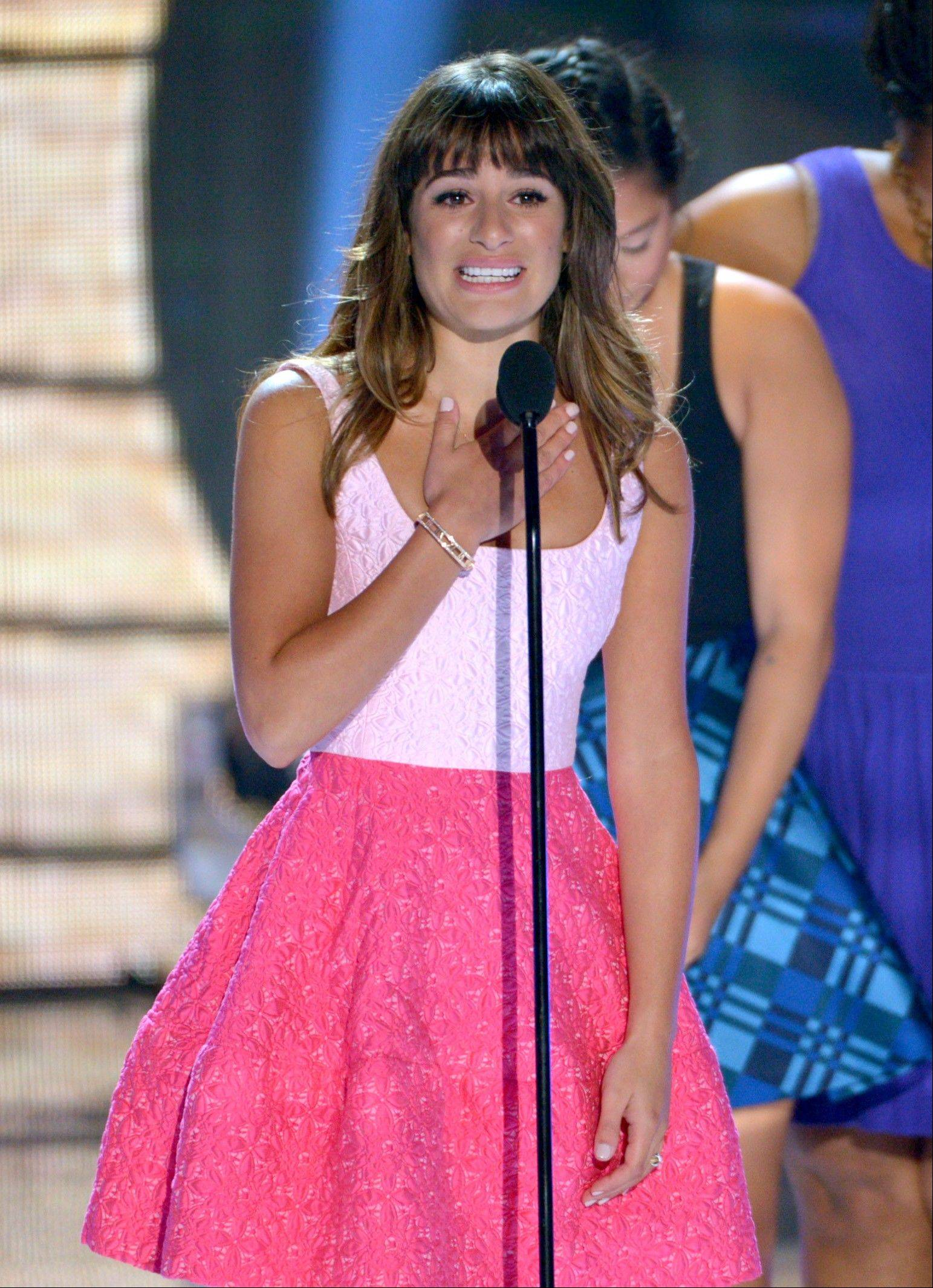 Actress Lea Michele speaks on stage at the Teen Choice Awards at the Gibson Amphitheater on Sunday in Los Angeles. Michele dedicated her award to her late boyfriend and co-star Cory Monteith.