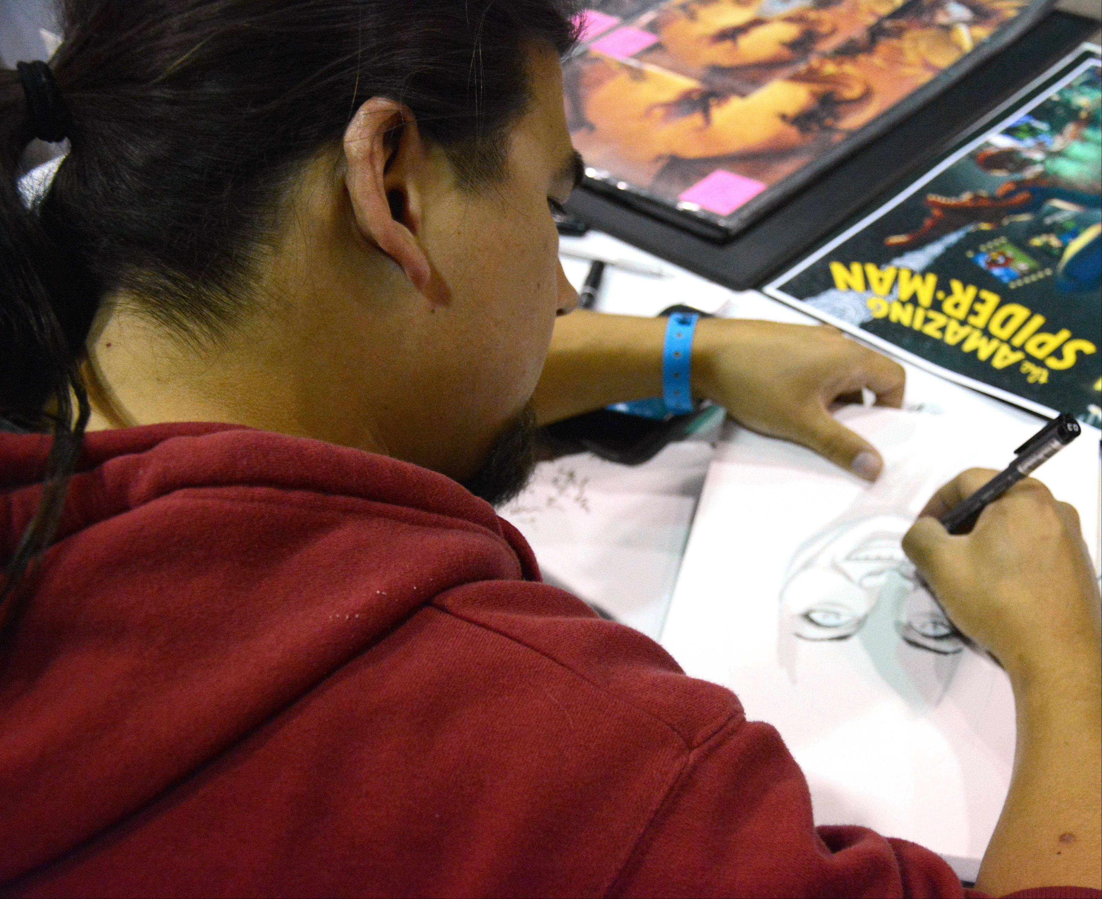 Mike Miller draws a portrait for a customer during Wizard World Chicago Comic Con in Rosemont Sunday.